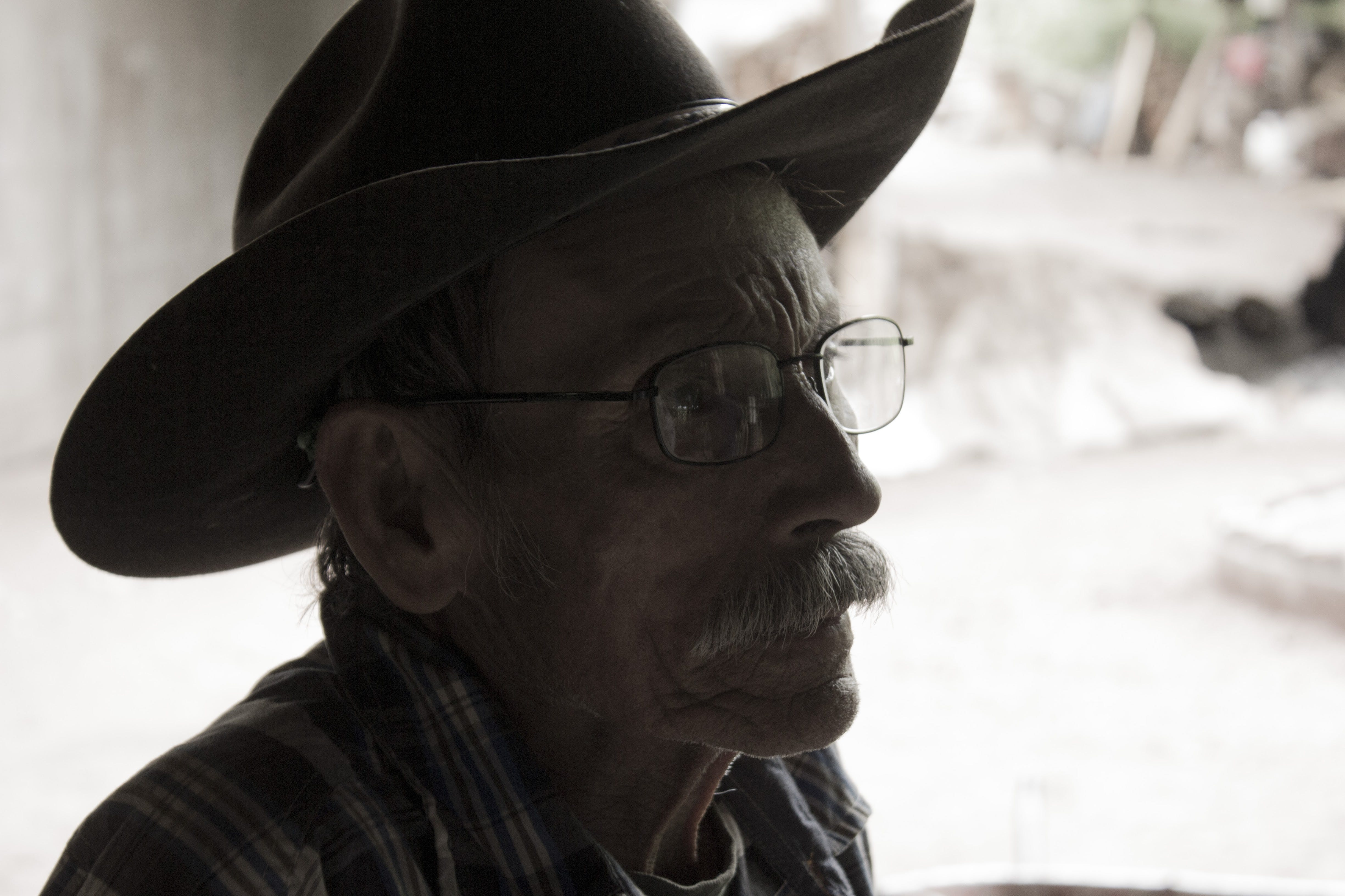 Man Wearing Eyeglasses and Cowboy Hat