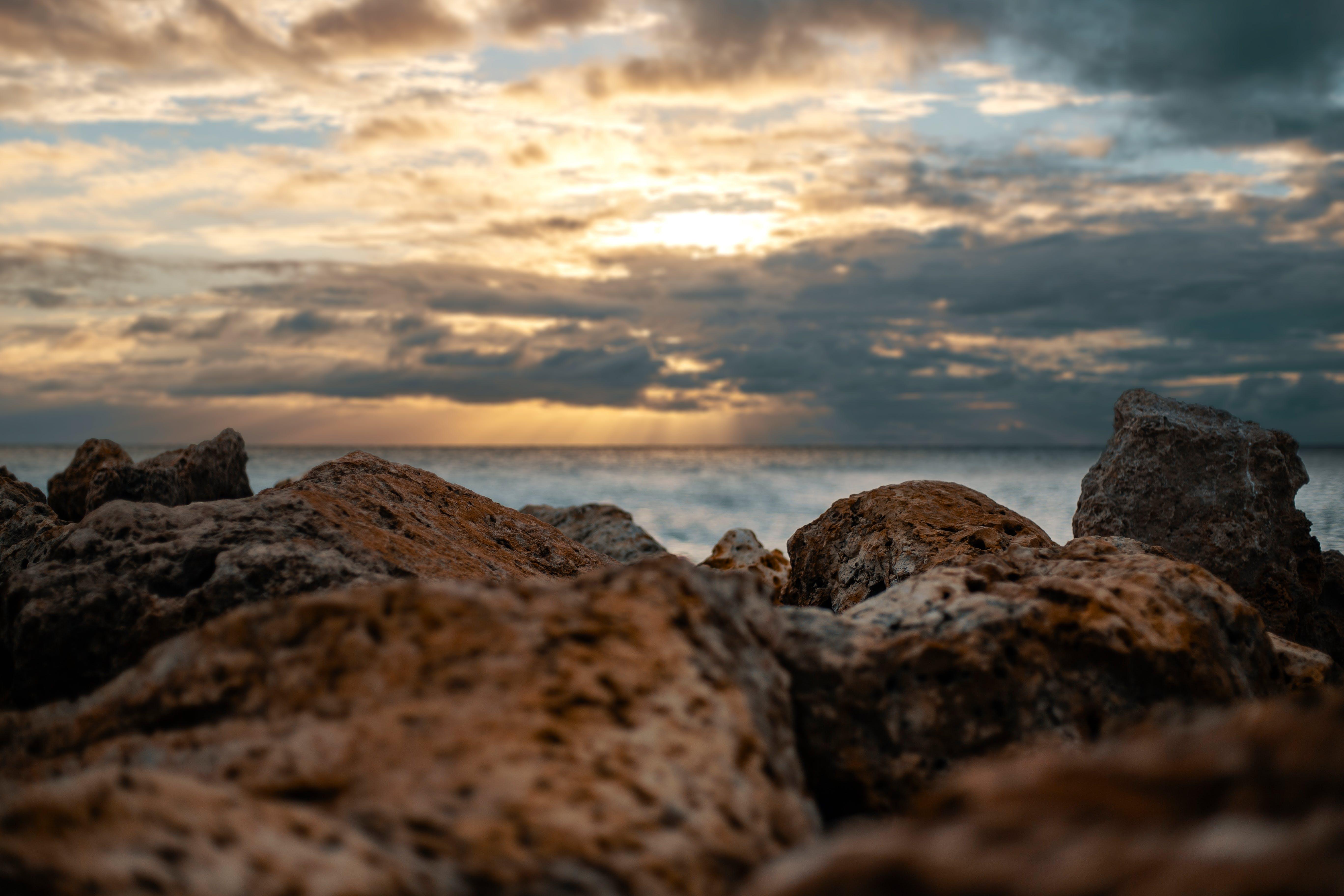 Brown Rocks Overlooking Body of Water