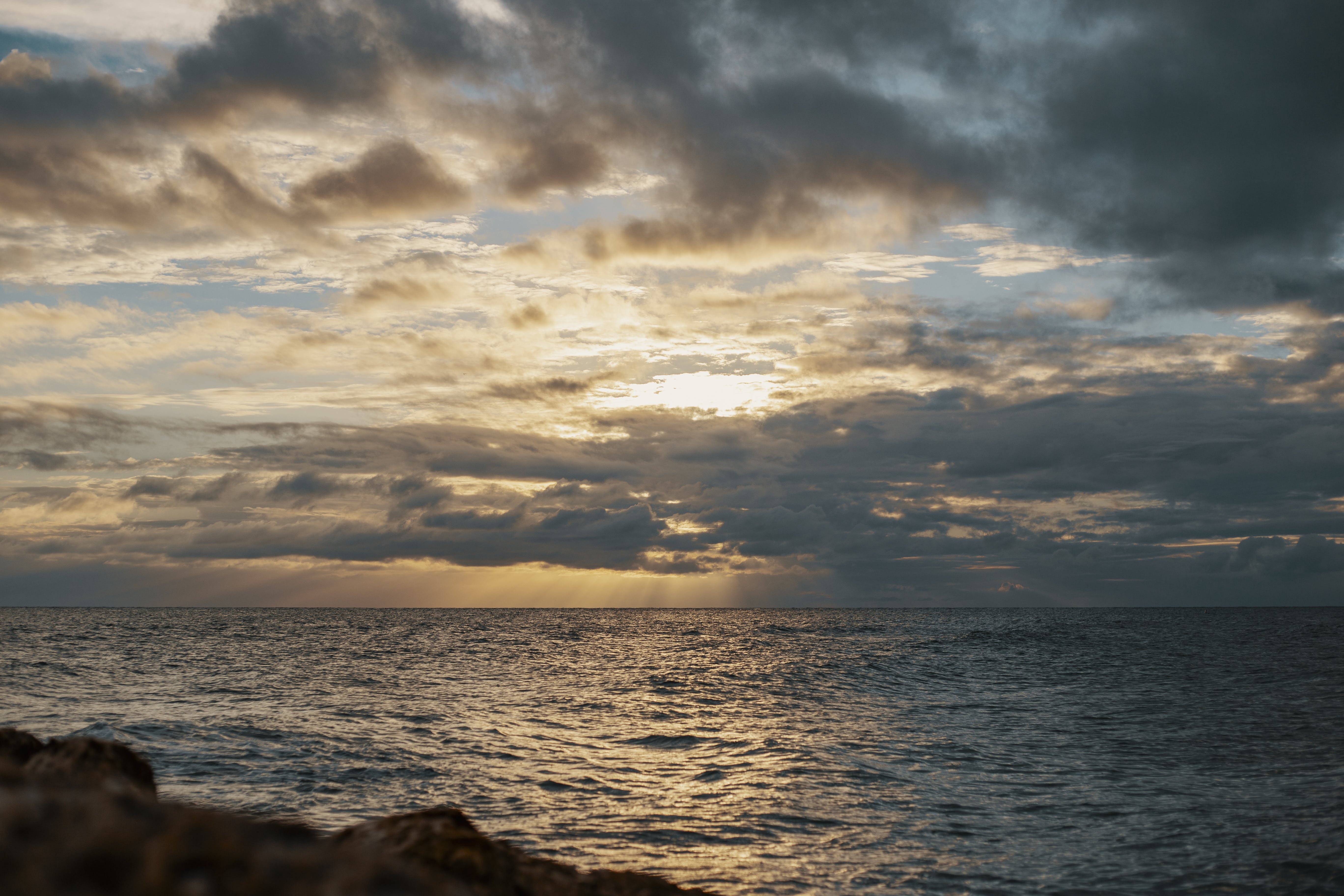 Sea Under Gray Cloudy Sky during Dawn