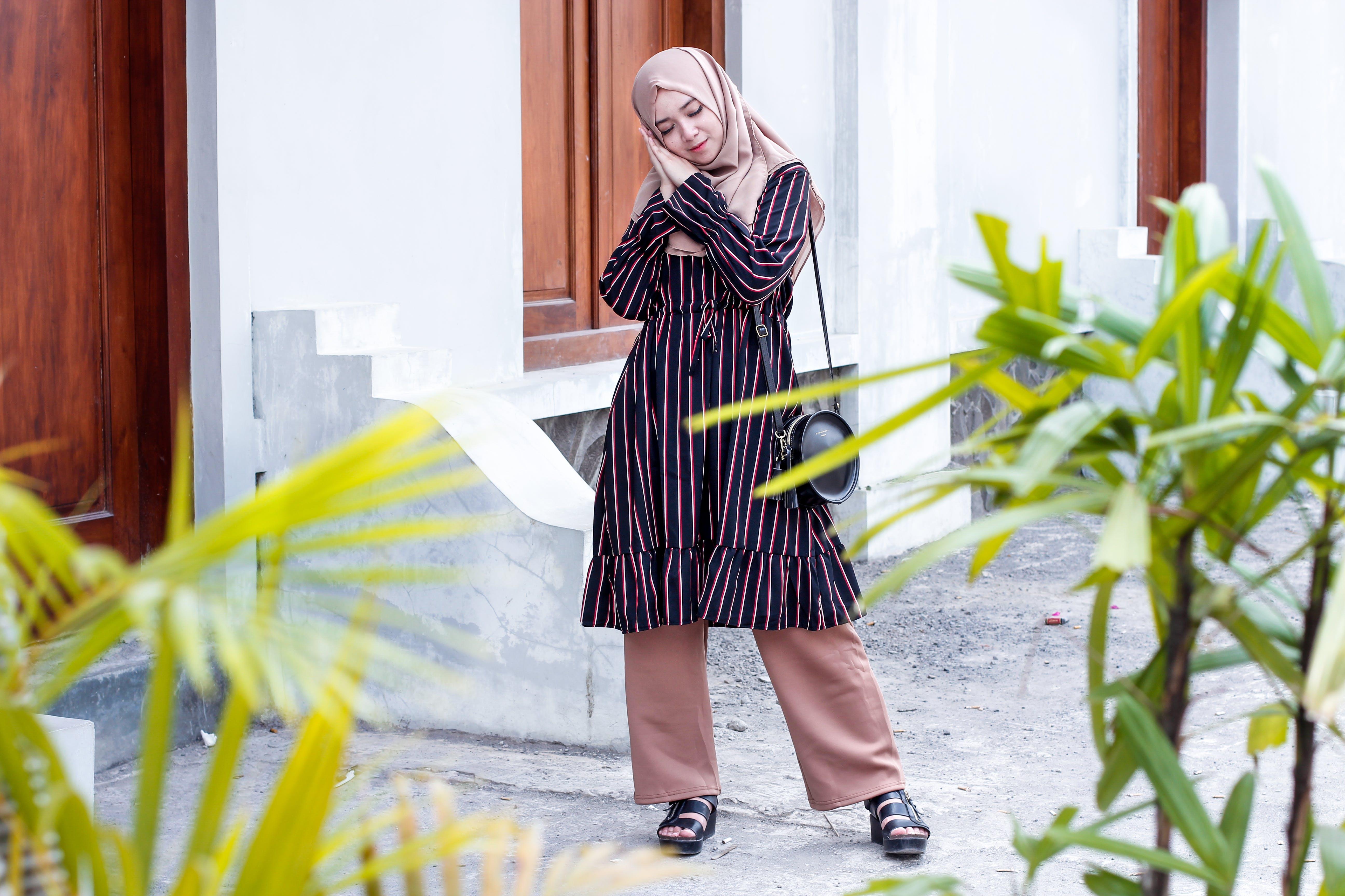 Woman Wearing Abaya Dress and Standing on Ground