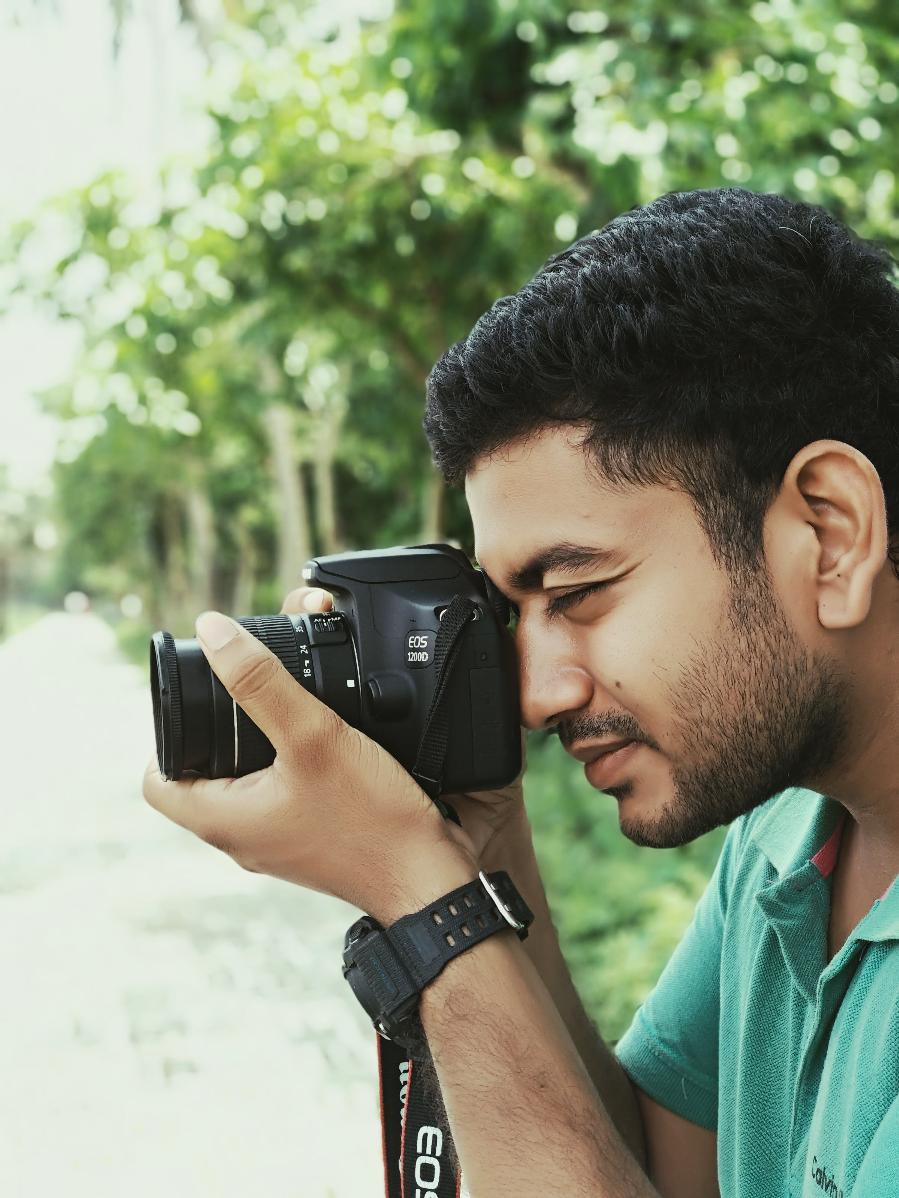 Man Using Canon Eos Camera