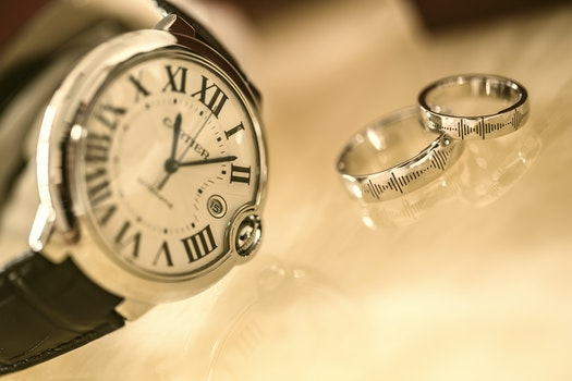 Silver Wedding Rings Near Silver Round Analog Watch