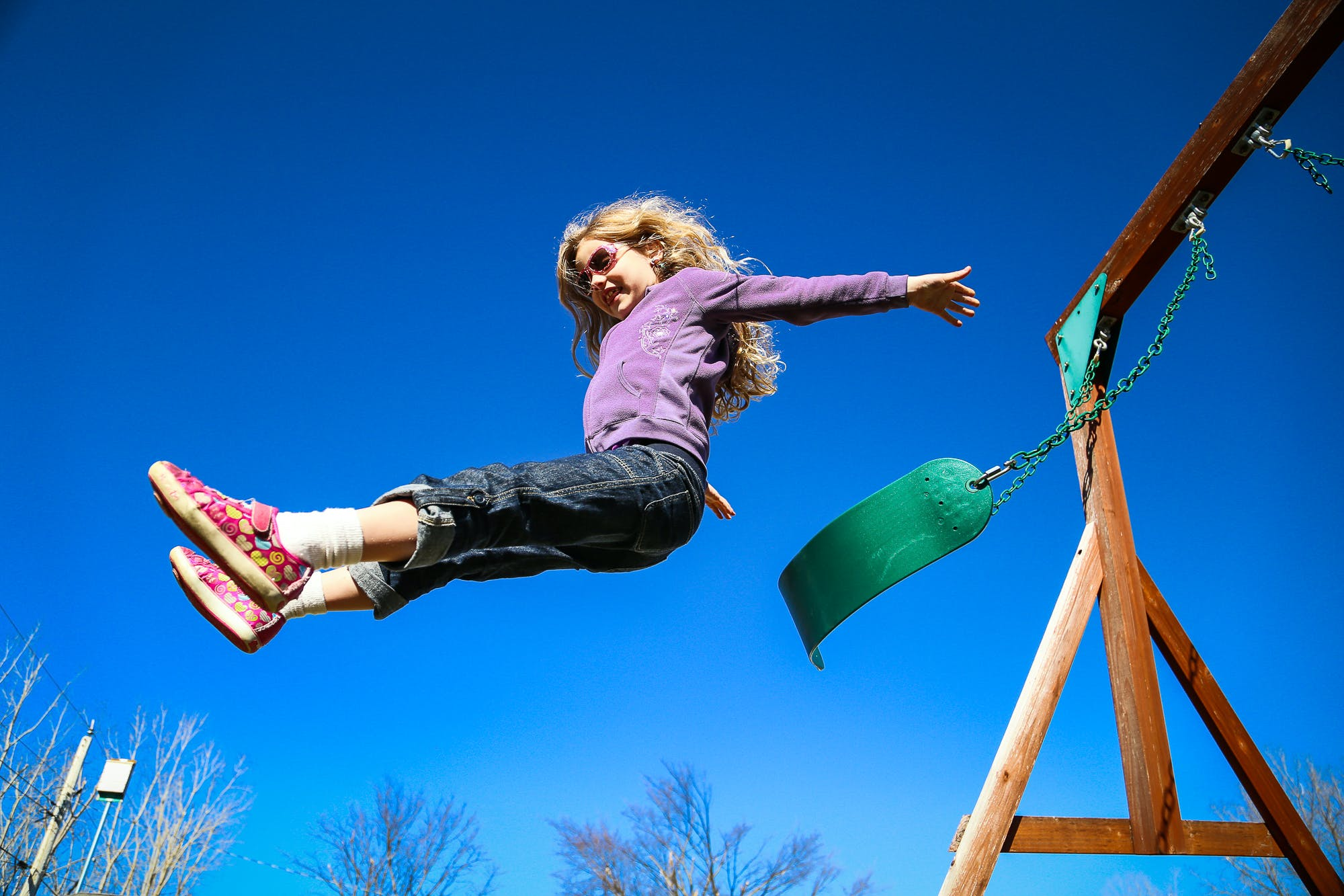 Free stock photo of flying, girl, jump off swing, swing