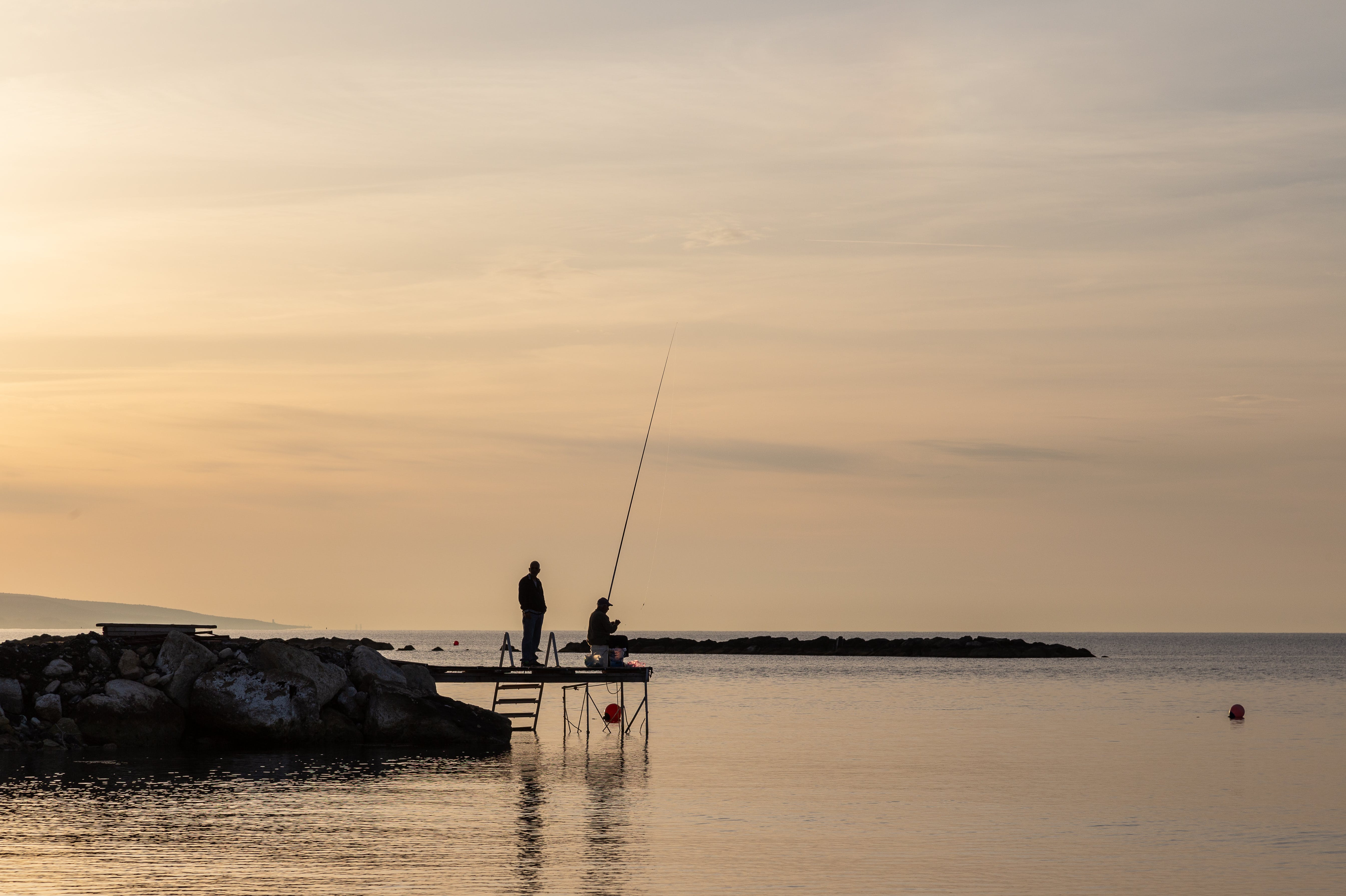 Two Person Having Fishing on Dock