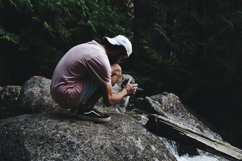 Man Wearing Pink Shirt Holding Dslr Camera