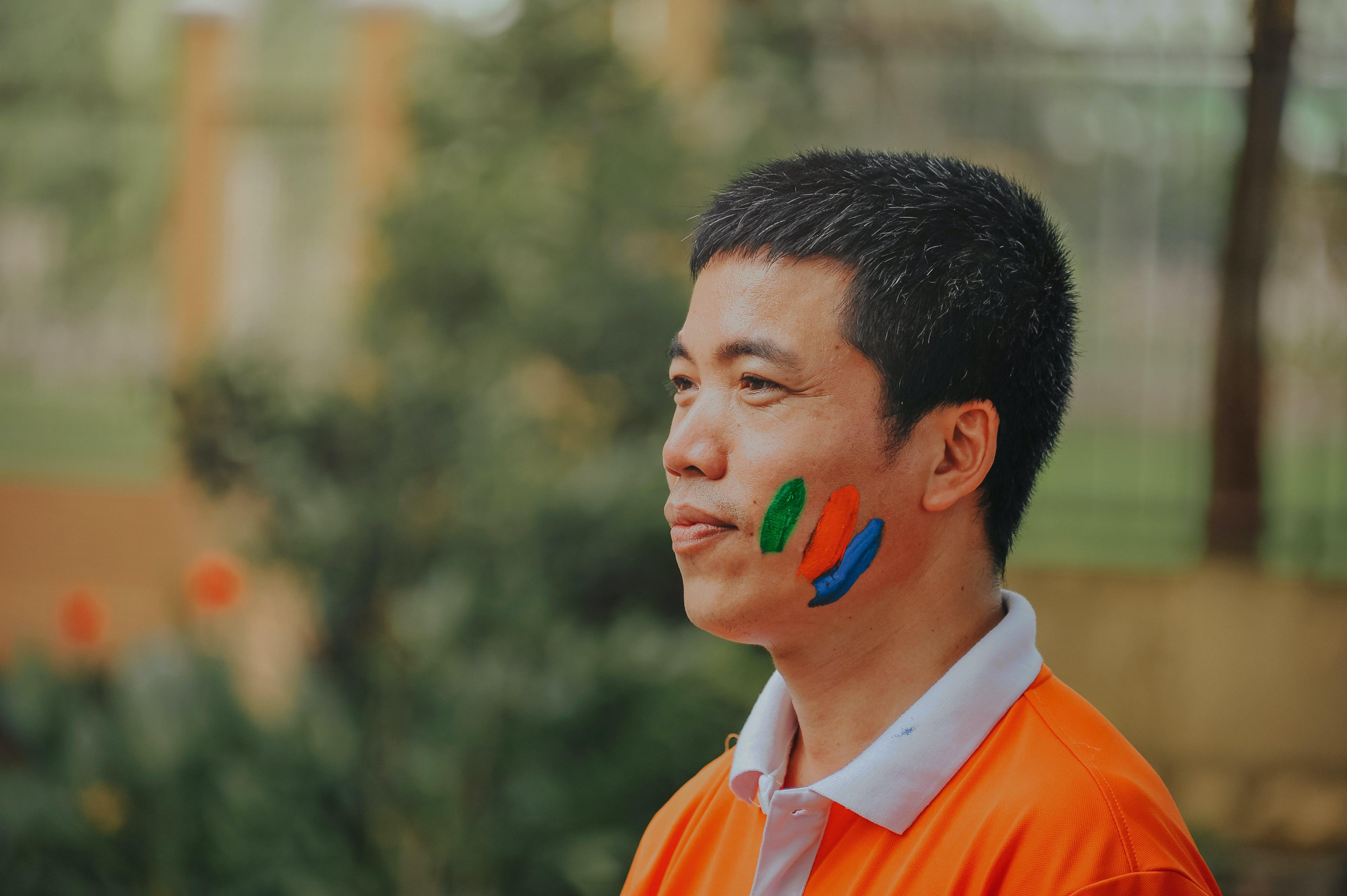 Man Wearing White and Orange Polo Shirt
