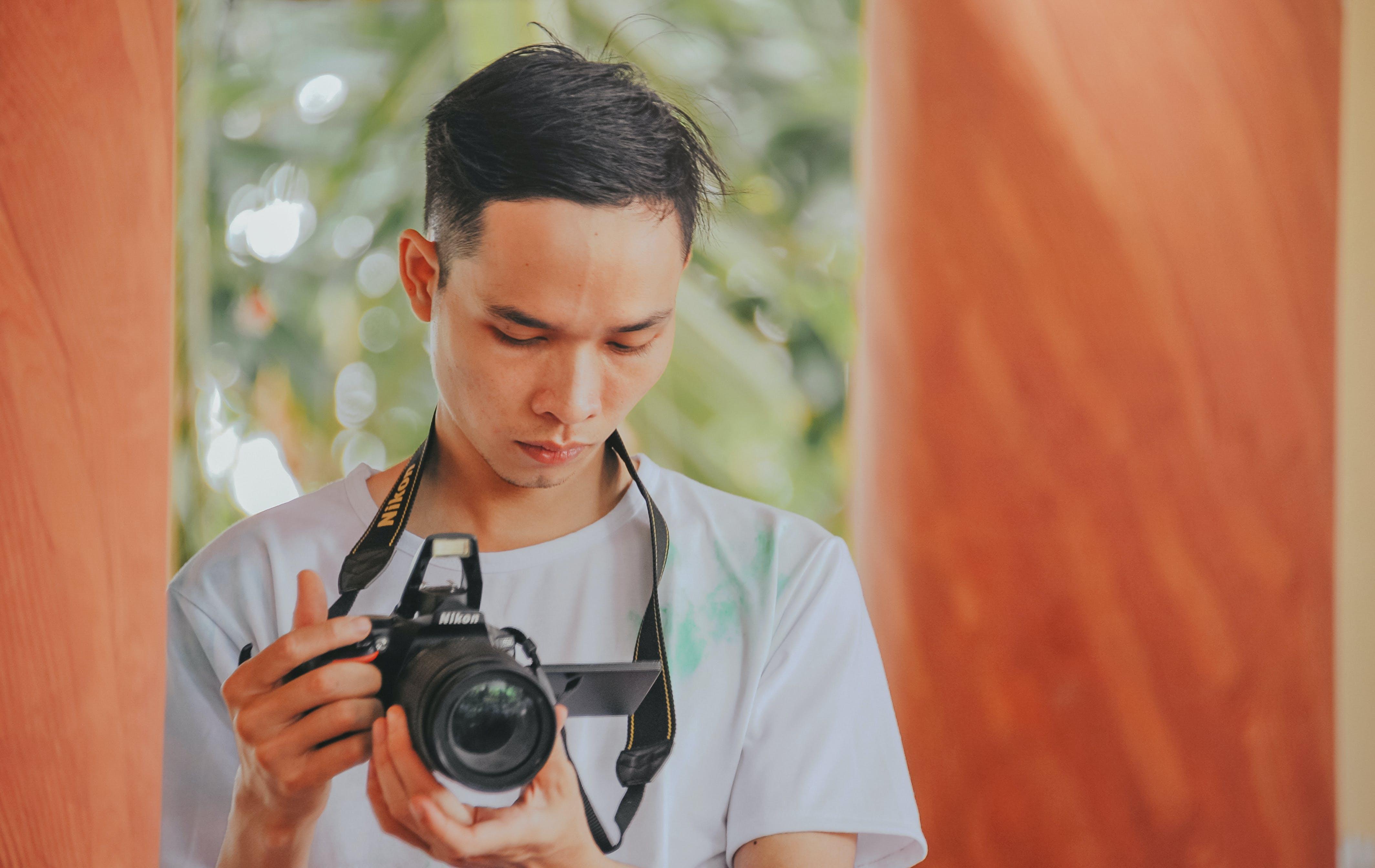 Person Holding Nikon Camera