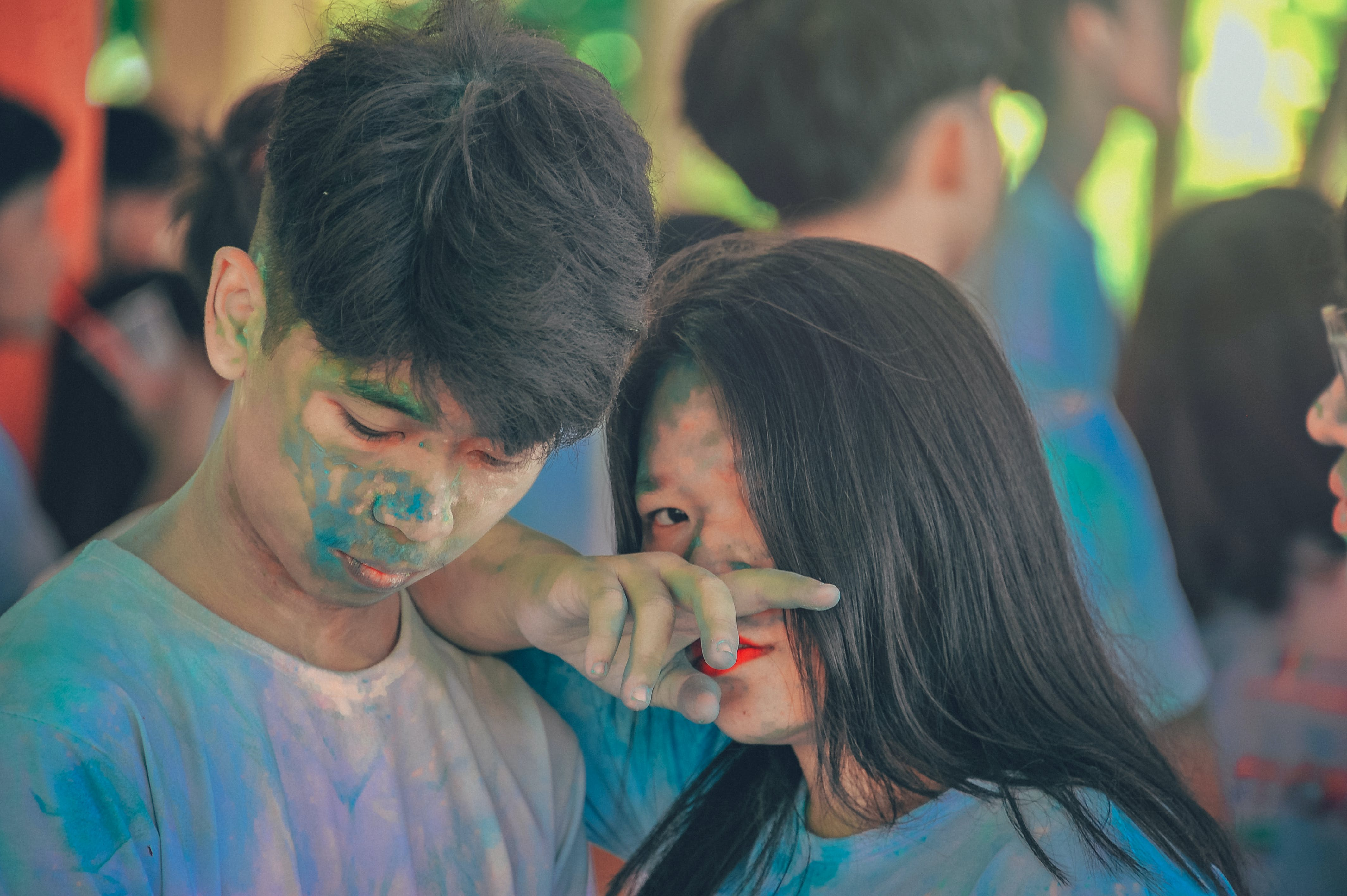 Man and Woman Covered in Blue Powder