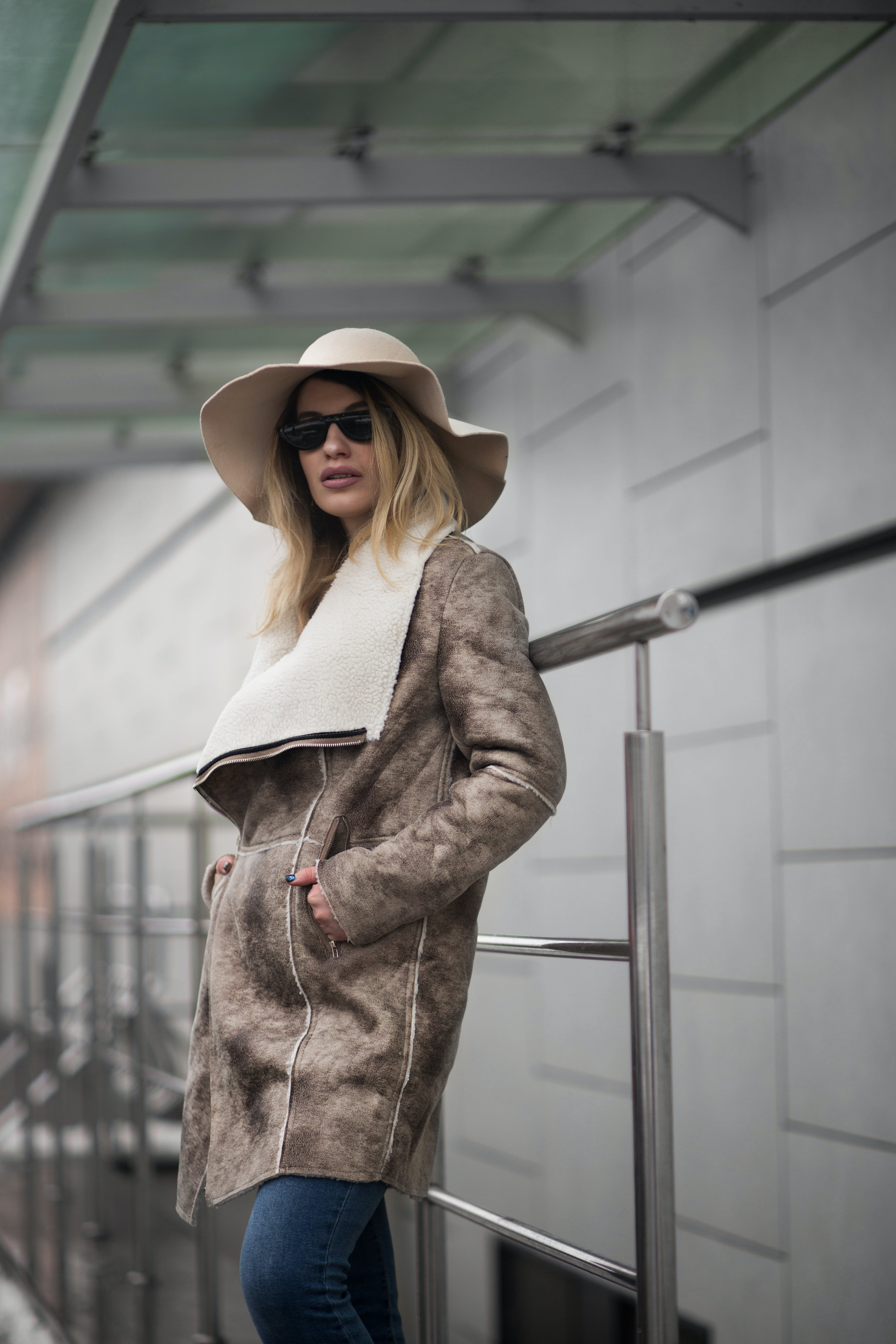 Woman in Brown Suede Coat and Sun Hat