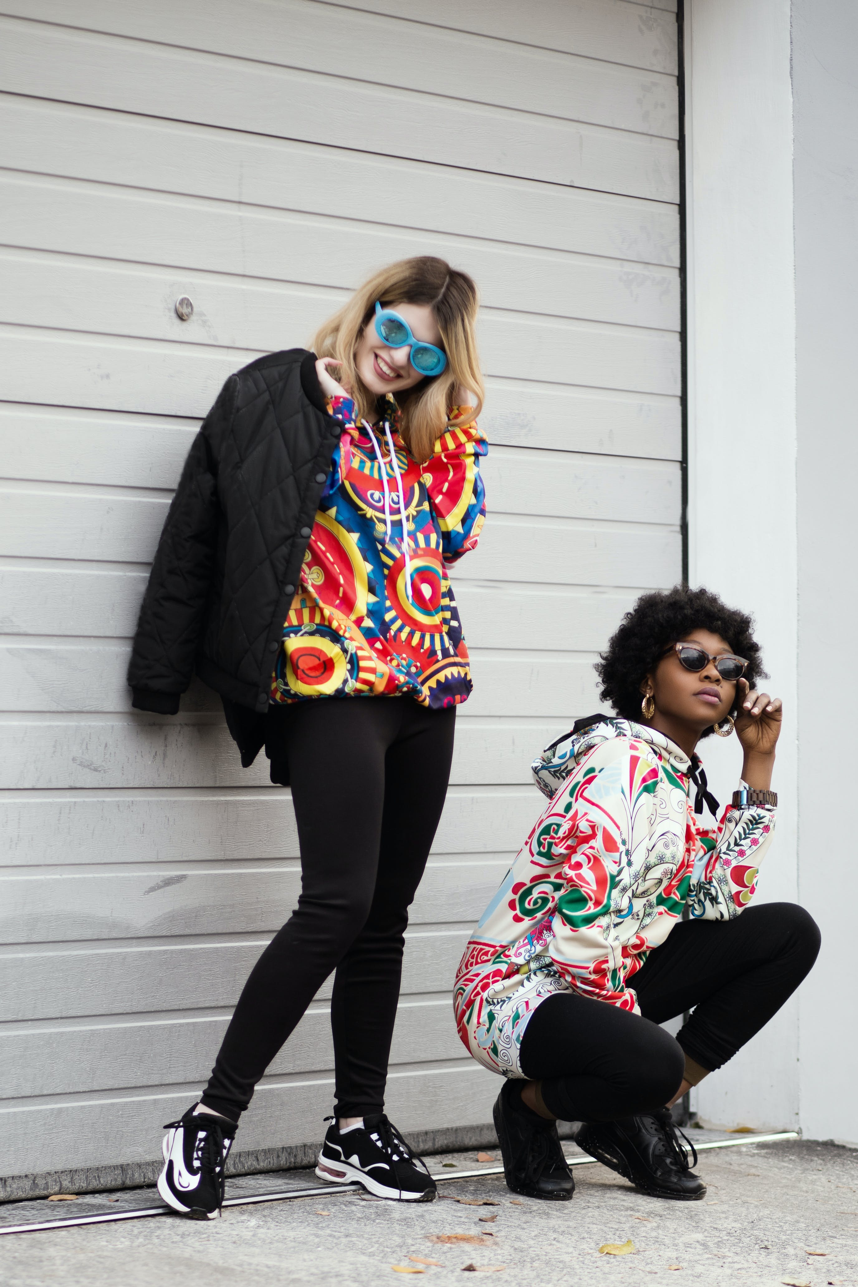 Women Wearing Multicolored Pullover Hoodie and Black Jacket