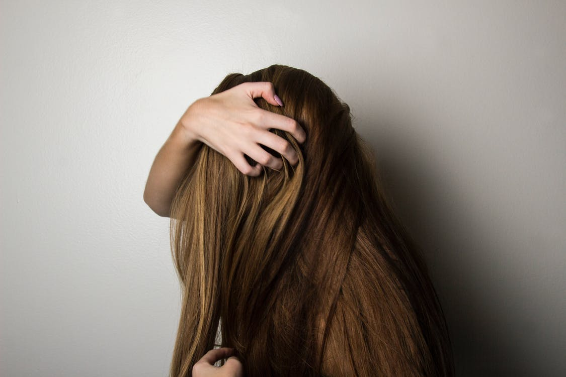 Photo of Woman Covering Face with Her Hair.