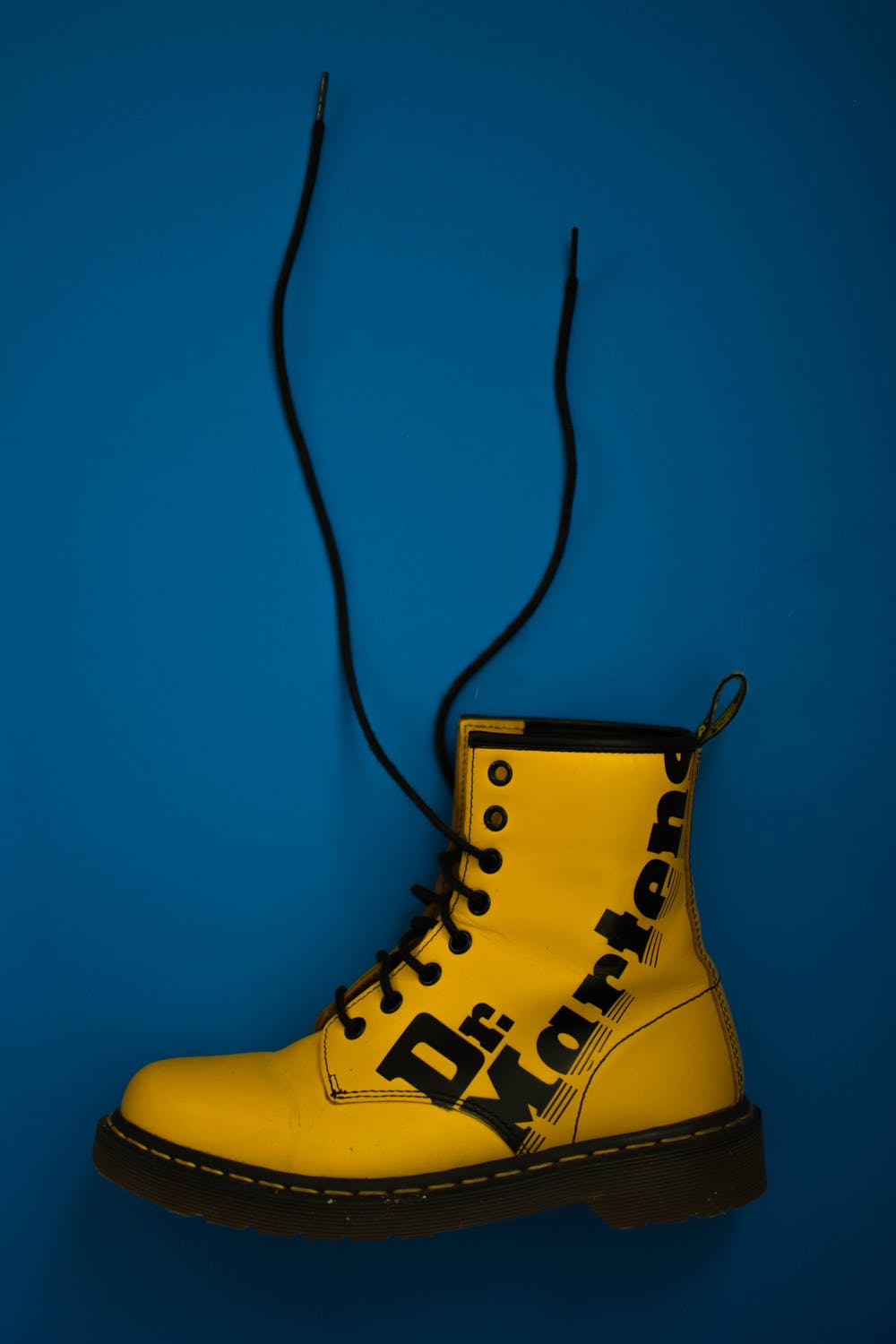 Yellow Dr. Martens lace-up boot. | Photo: Pexels