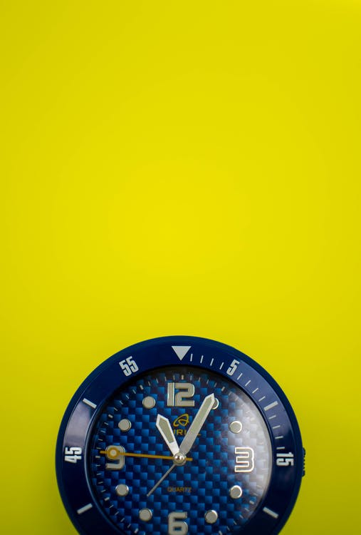 Closeup Photo of Round Blue Analog Watch