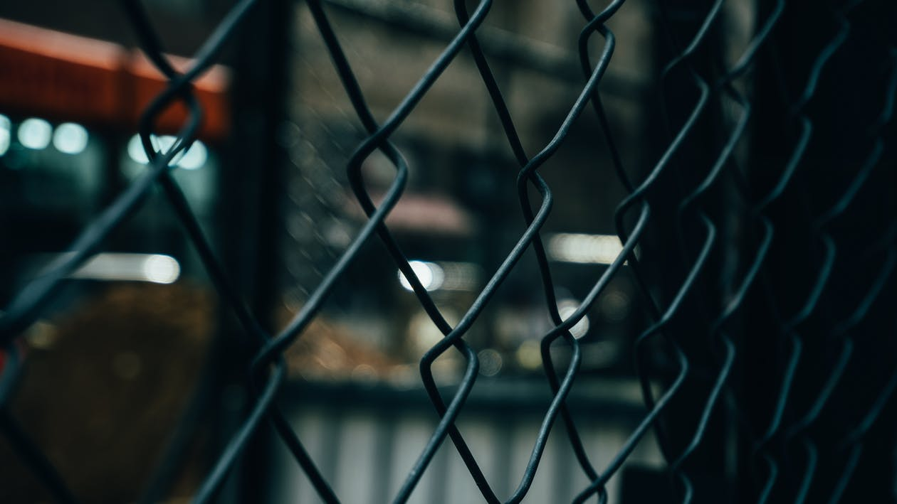 Close-up Photography of Gray Metal Chainlink Fence