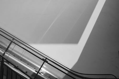 Black and White Photo of Escalators