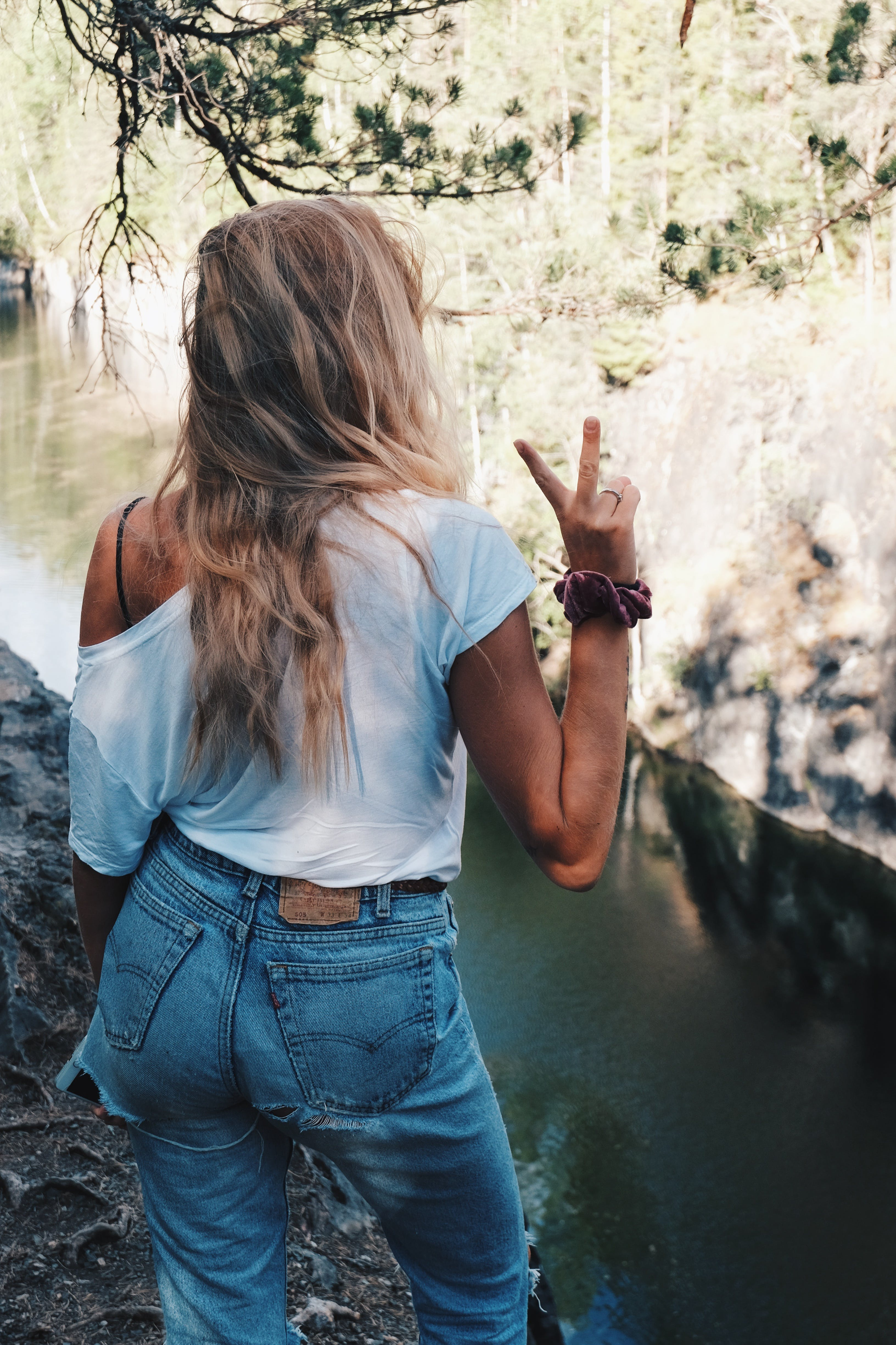 Woman in White Shirt Standing over the River Bank