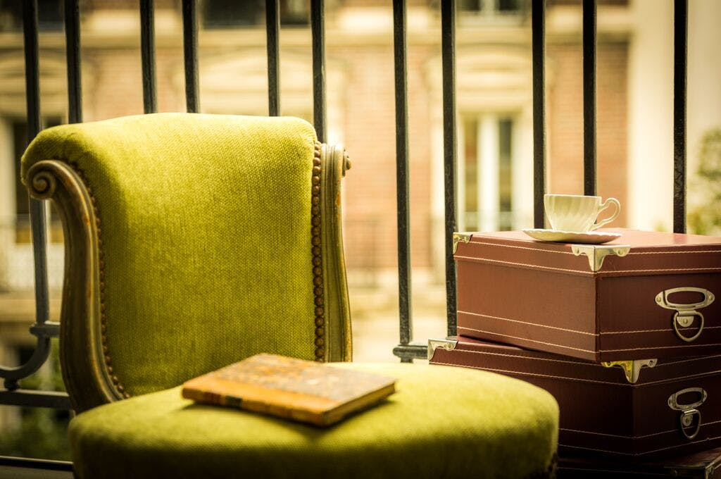 Yellow Book on Green Ottoman