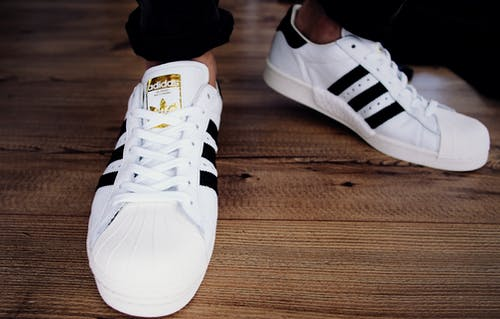Pair of White-and-black Adidas Superstars