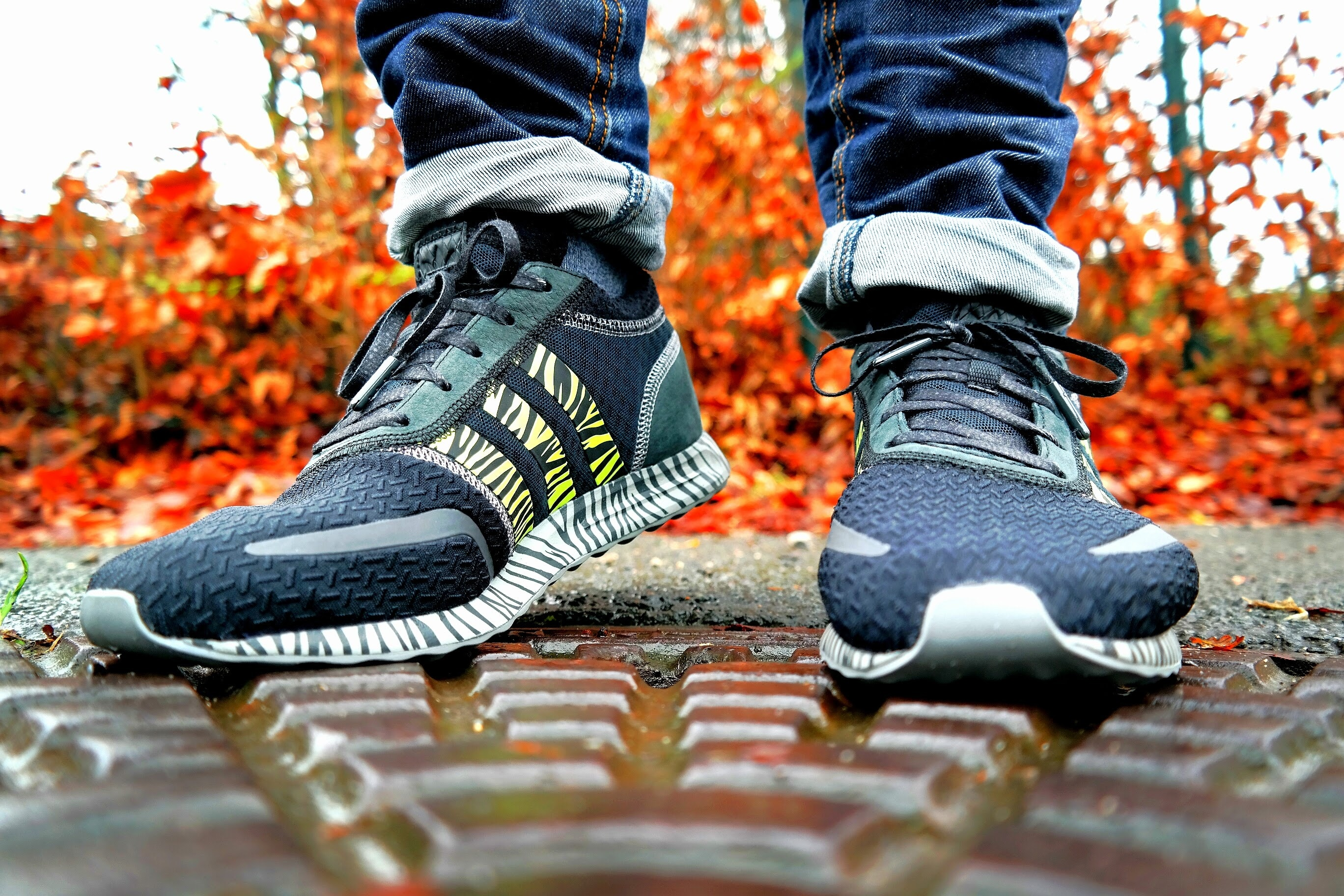 22a0a857f382e9 Shallow Focus Photography of Pair of Black Black-and-white Adidas ...