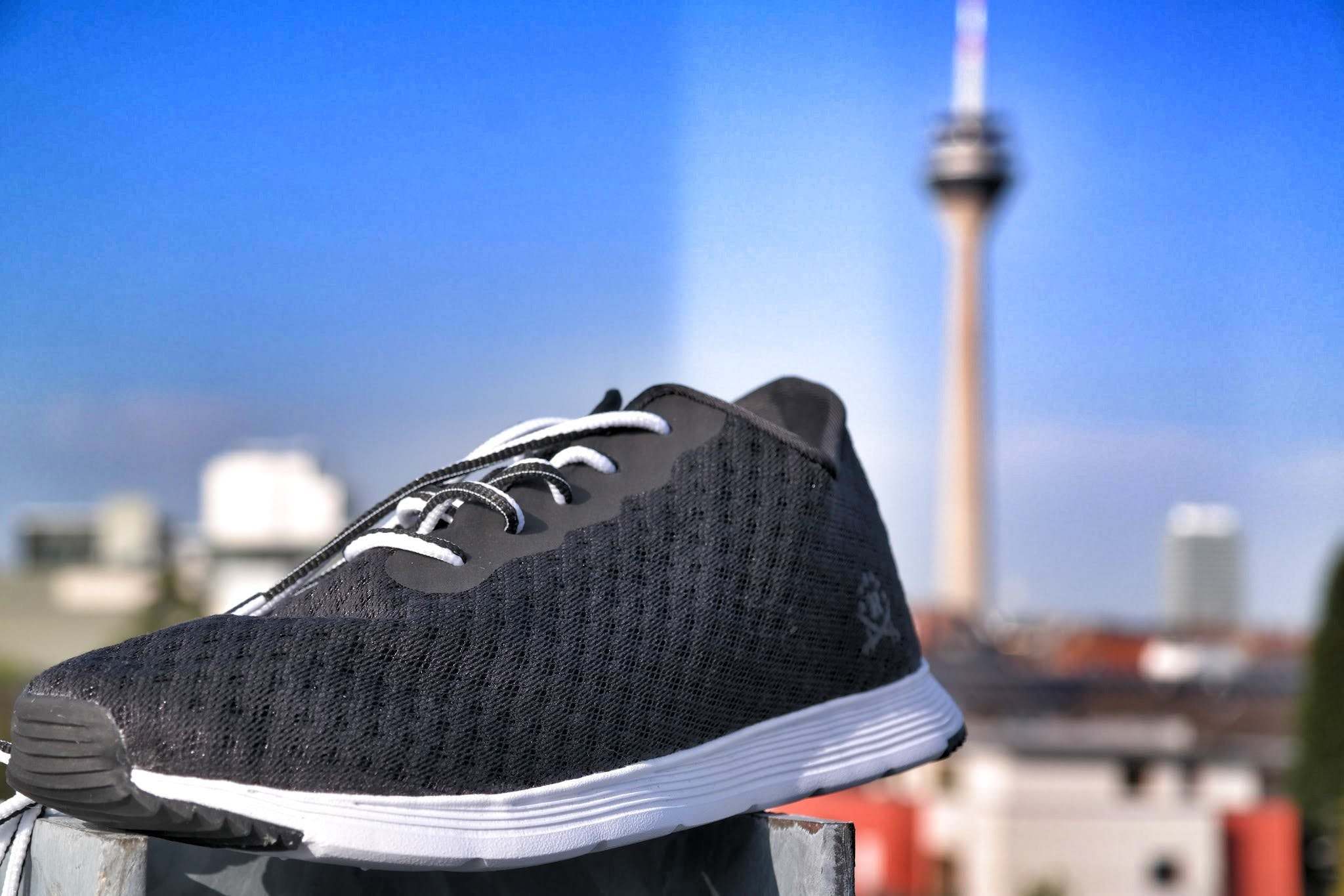 Unpaired of Black and White Lace-up Sneaker in Selective Focus Photography