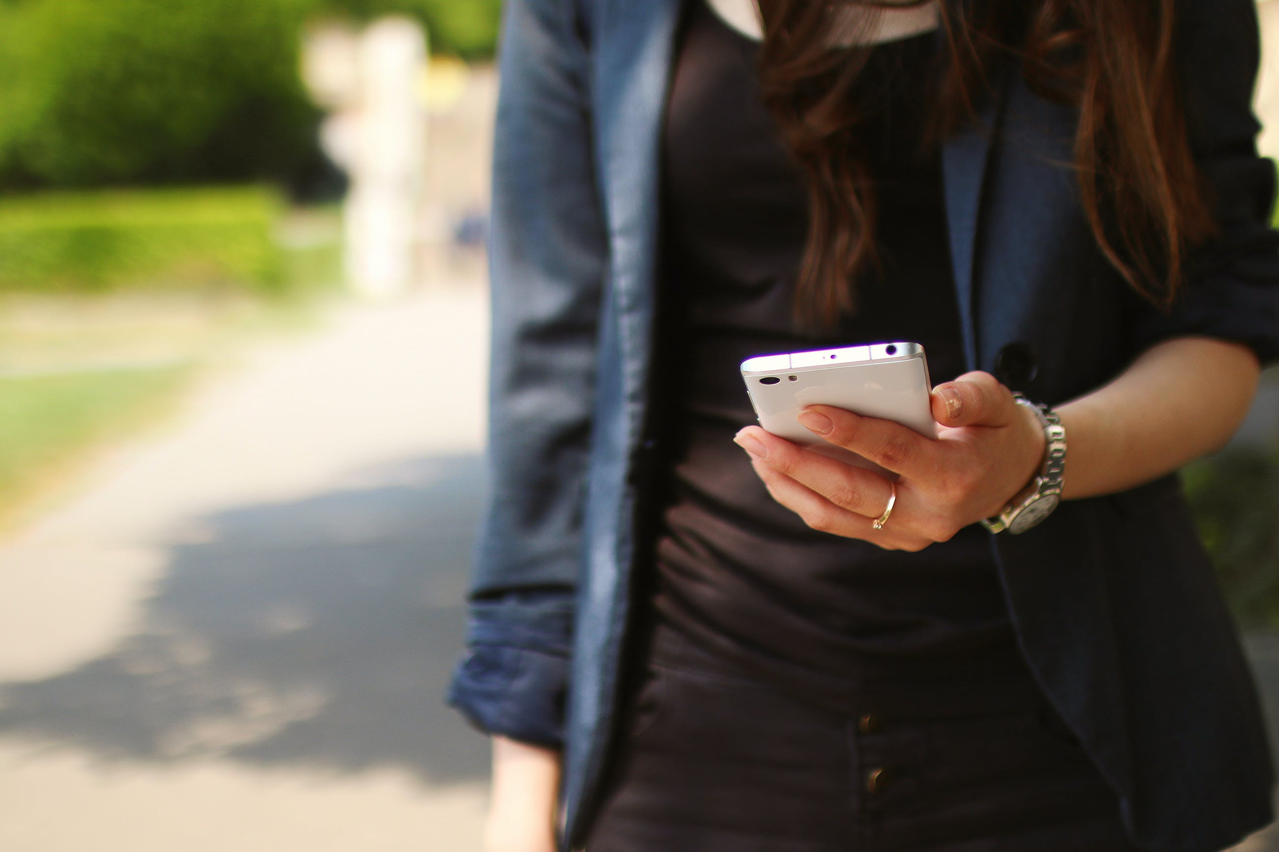 Woman Holding White Smartphone