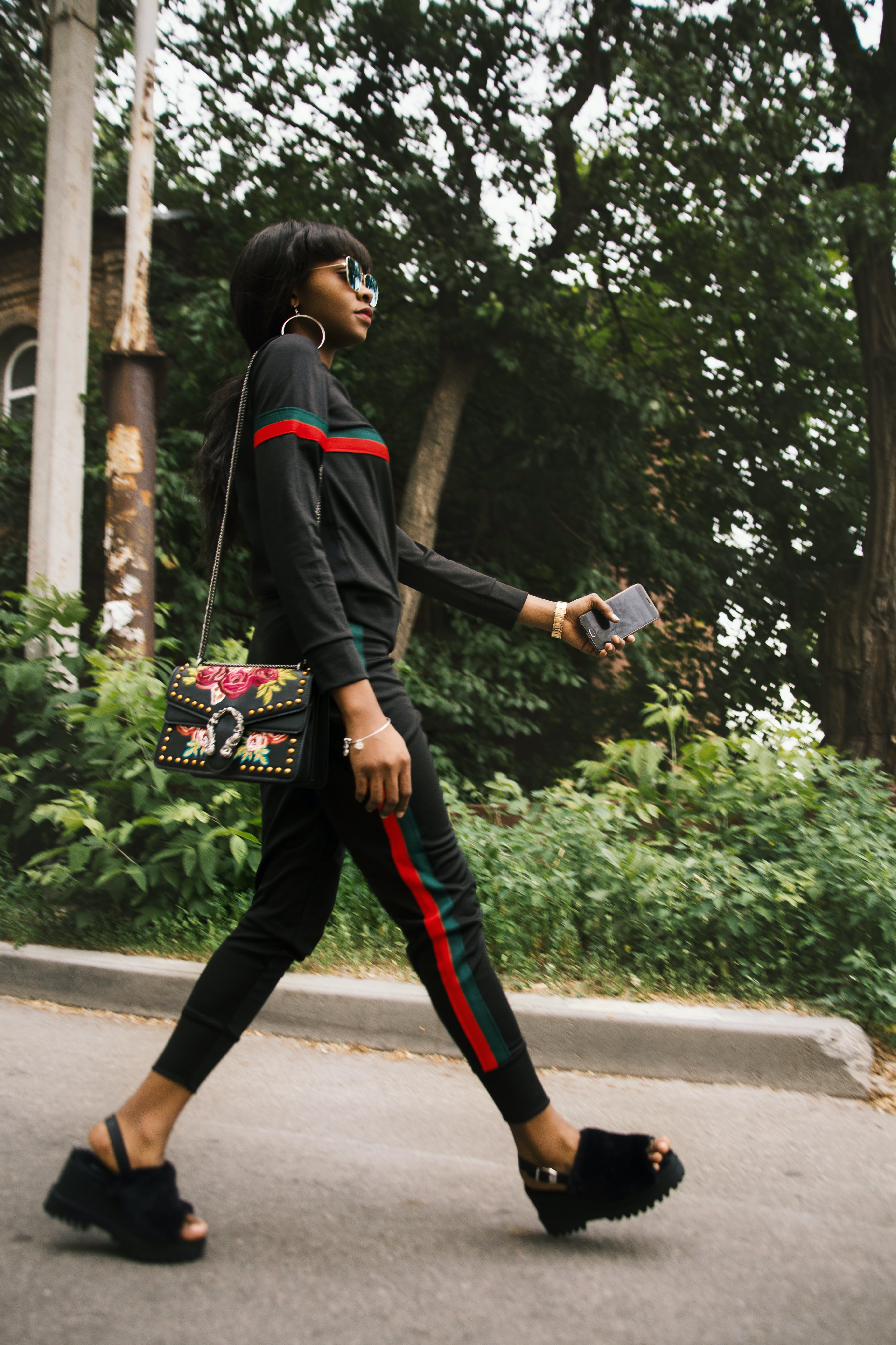 Woman Wearing Black Gucci Tracksuit