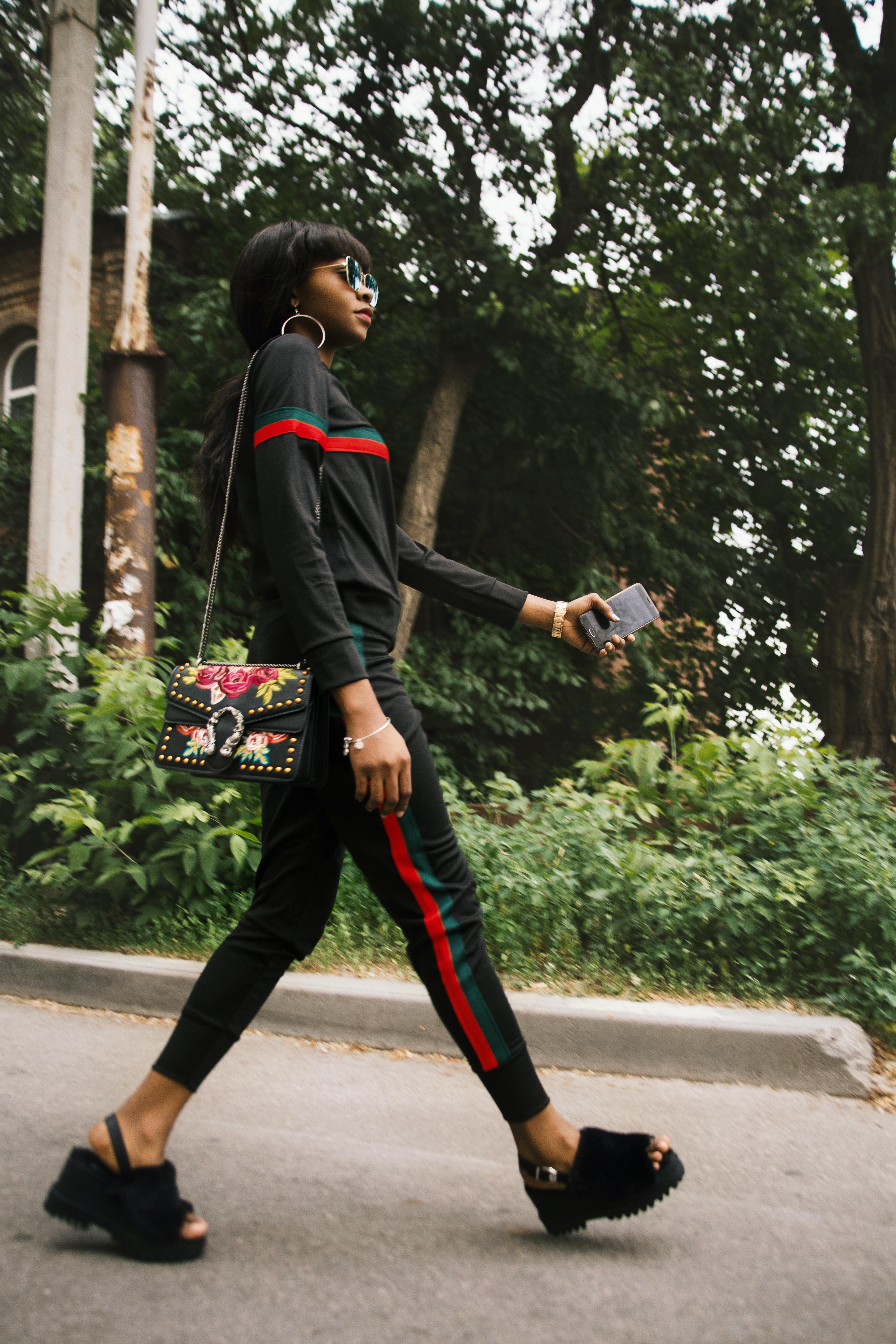 distinctive design buy cheap latest design Woman Wearing Black Gucci Tracksuit · Free Stock Photo