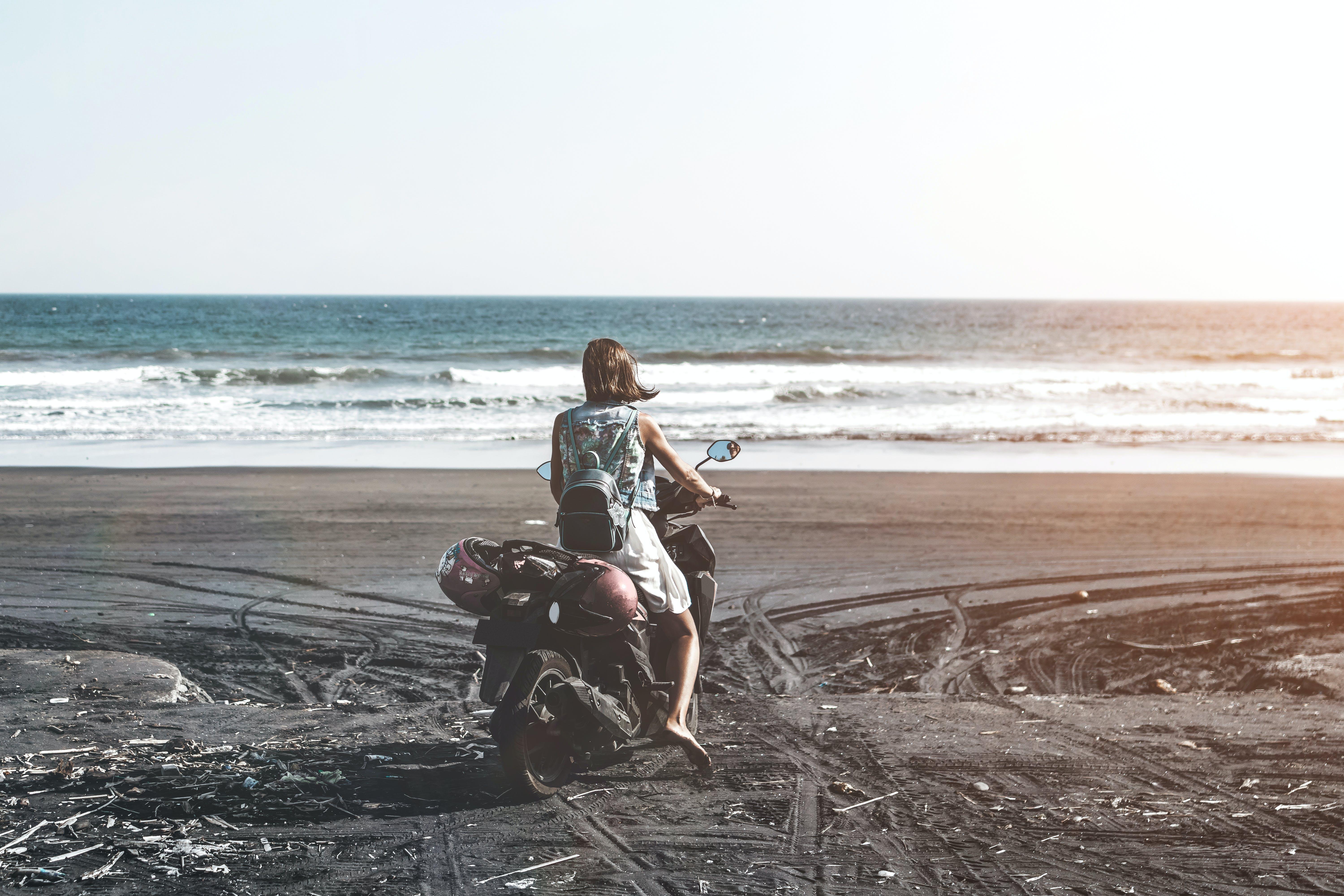 Woman Riding Motor Scooter on Seashore