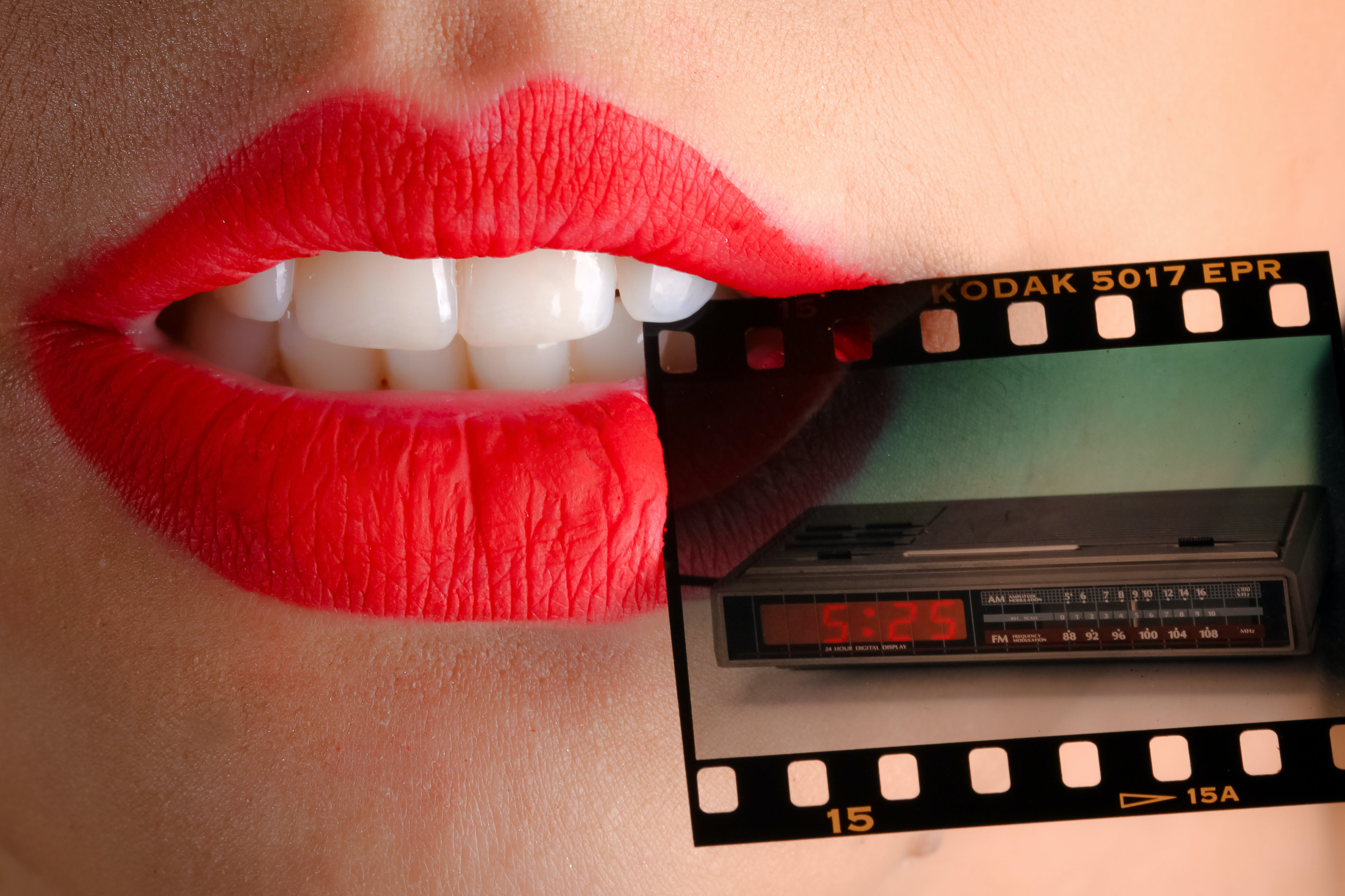 Person Wearing Red Lipstick Biting Film