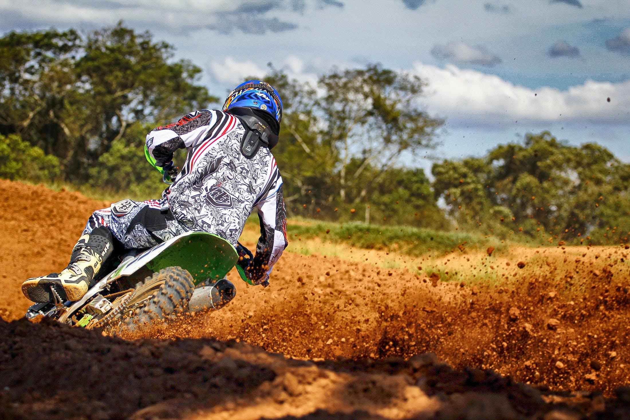 Man Riding Motocross Dirt Bike on Track