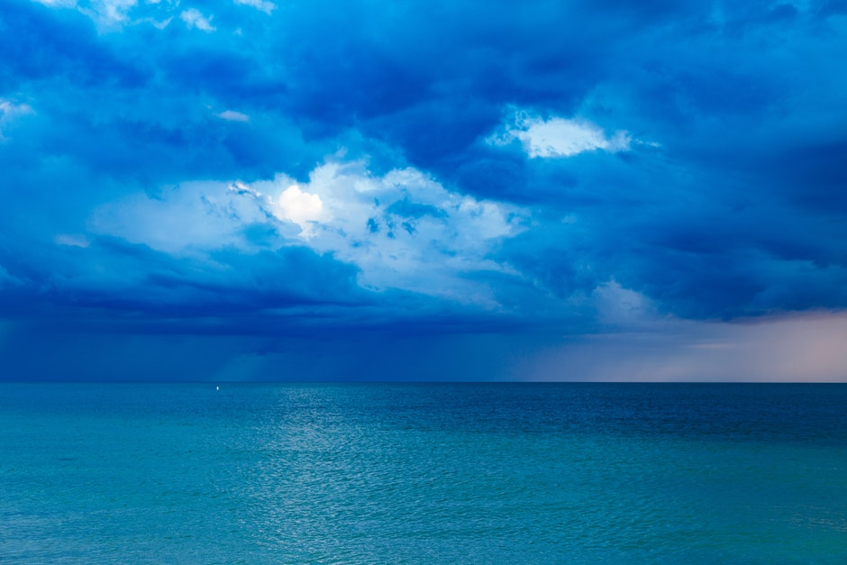 Blue Ocean With Cloudy Sky