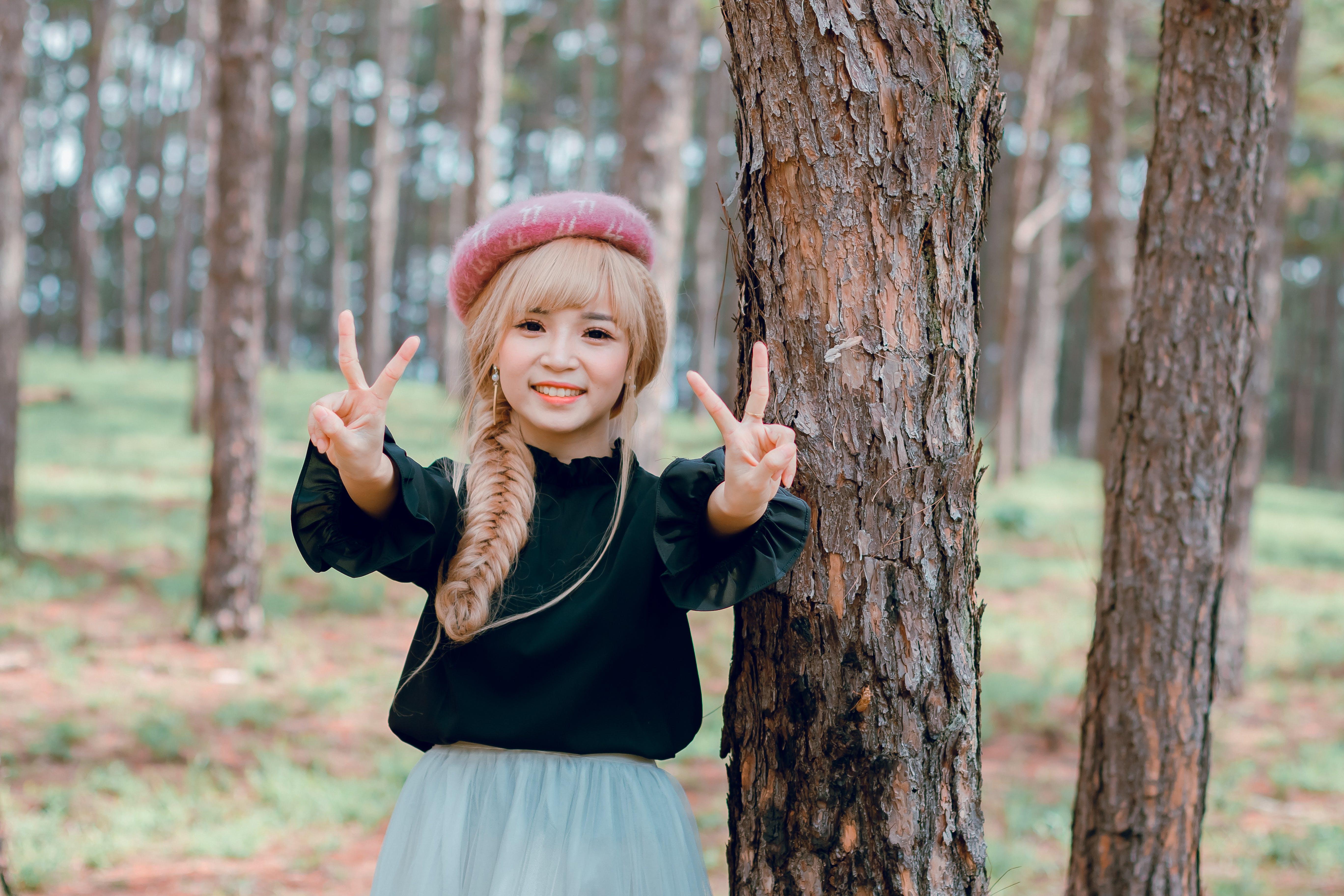 Girl Wearing Black Shirt Standing Near Tree