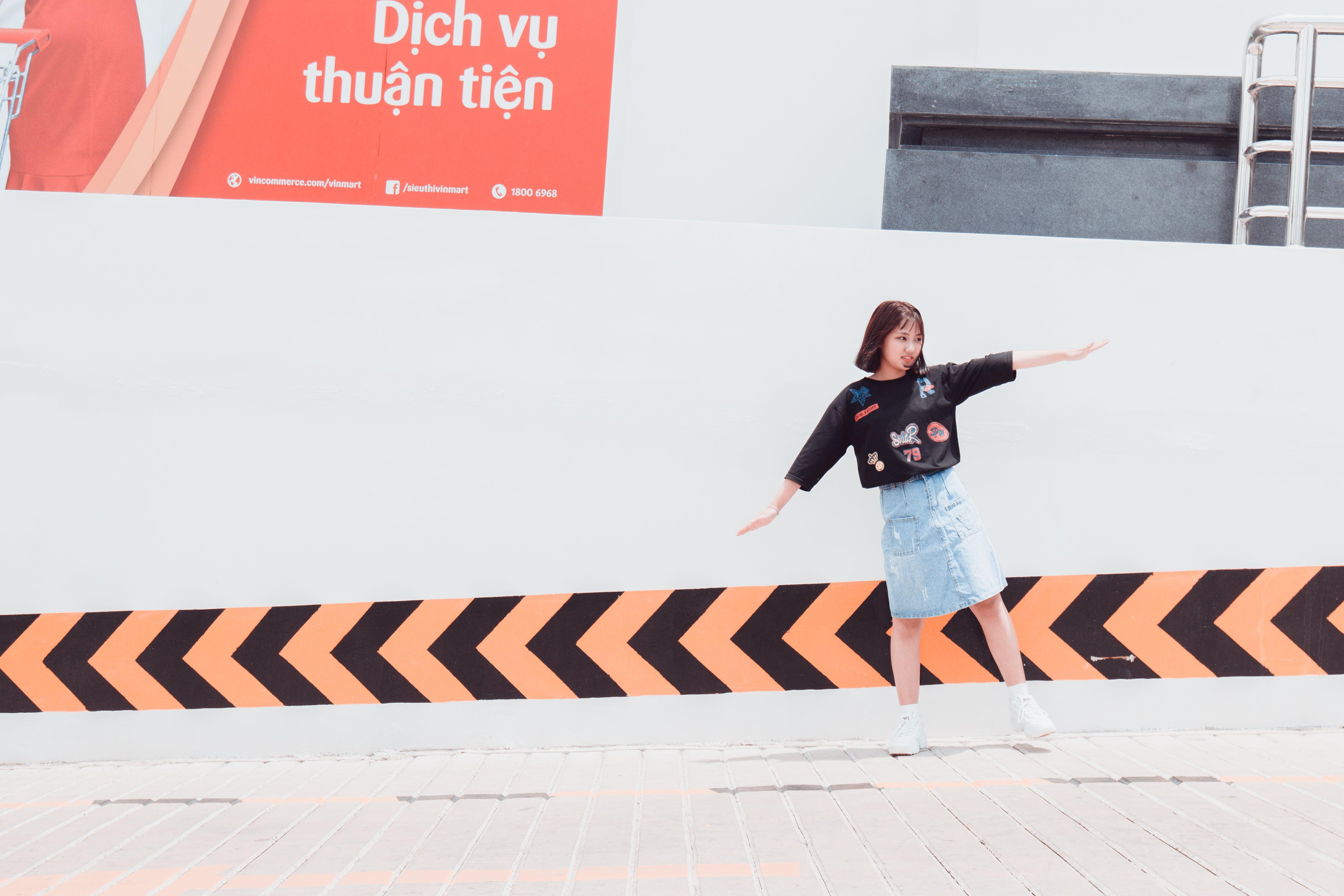 Woman in Black Shirt Standing Near Building