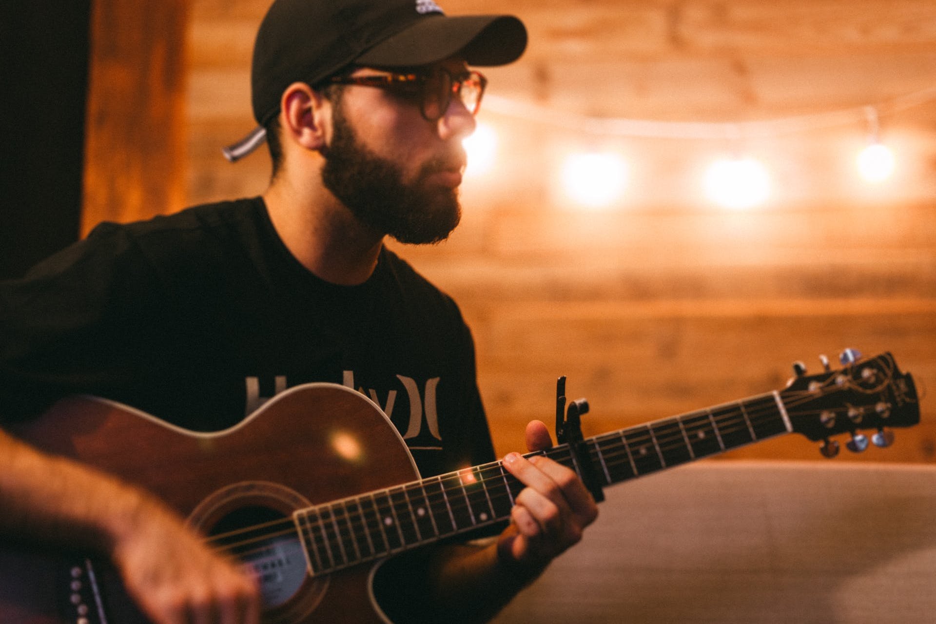Free stock photo of acoustic guitar, calm lights, candlelight, church music