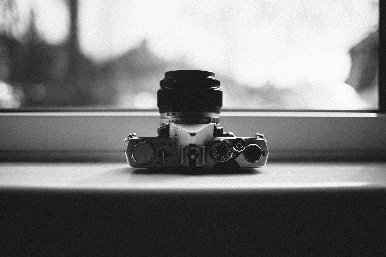 Grayscale Photo of Gray Mirrorless Camera