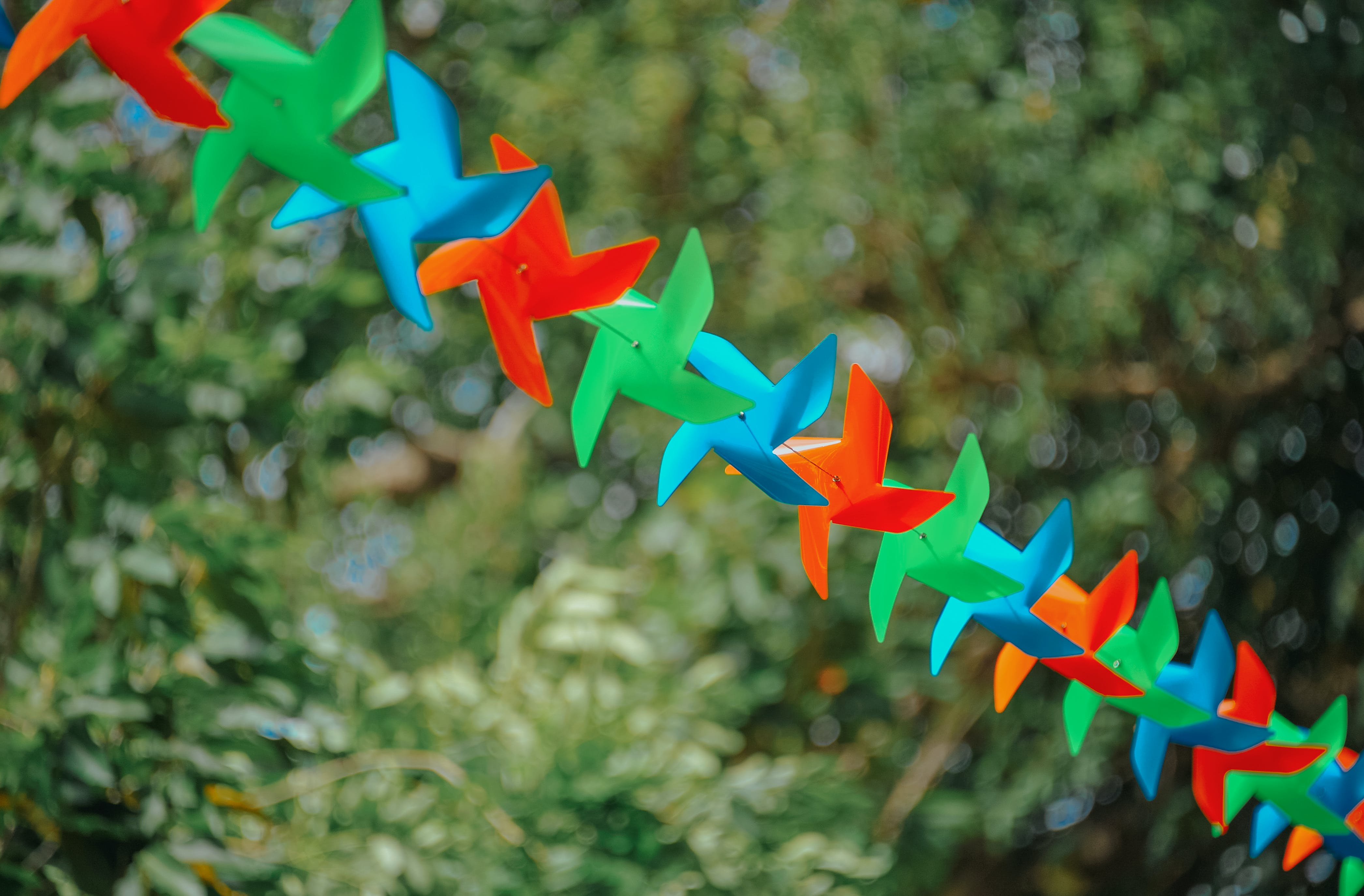Selective Focus Photography of Pinwheels on String