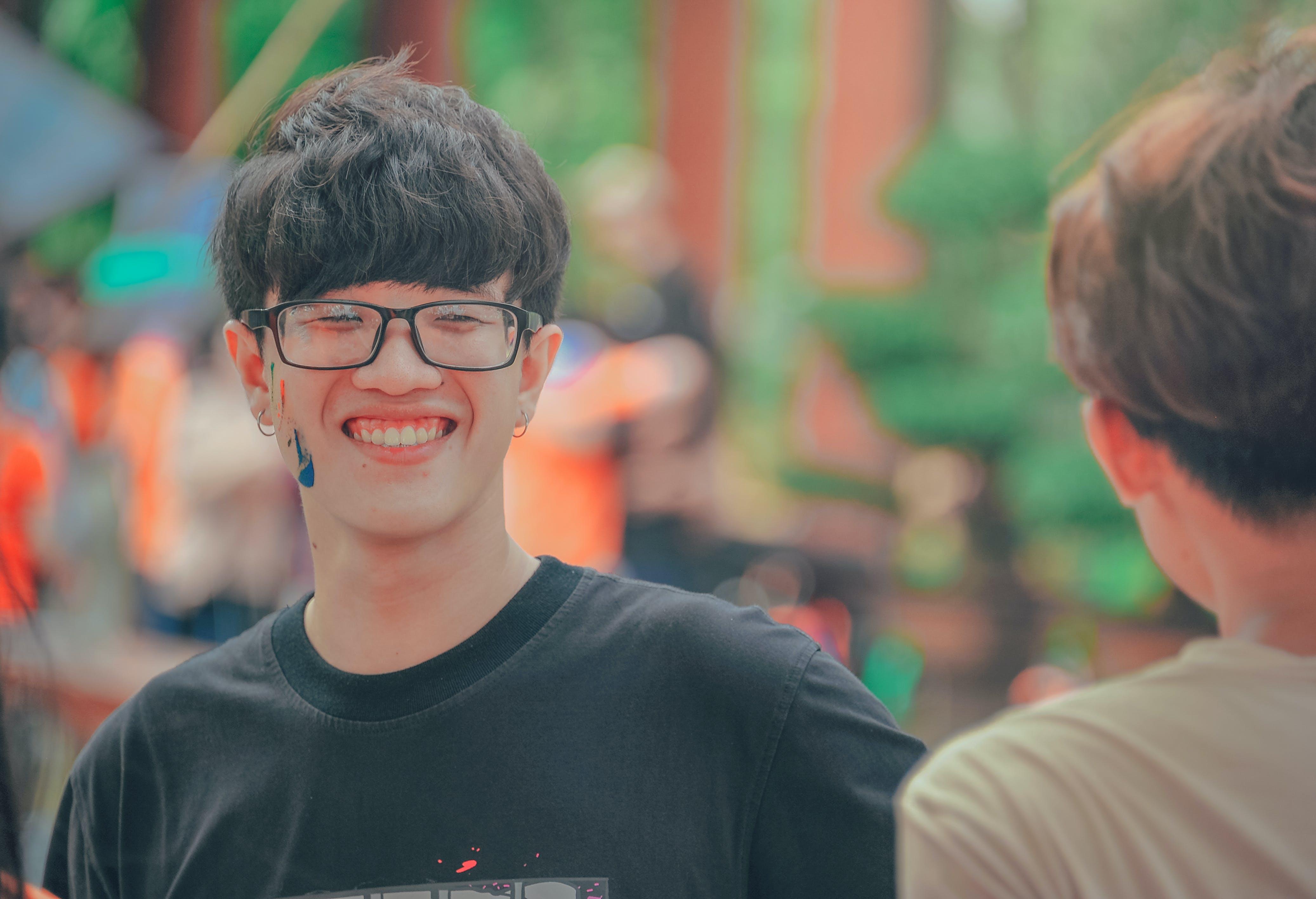Smiling Man in Black Shirt Wearing Eyeglasses