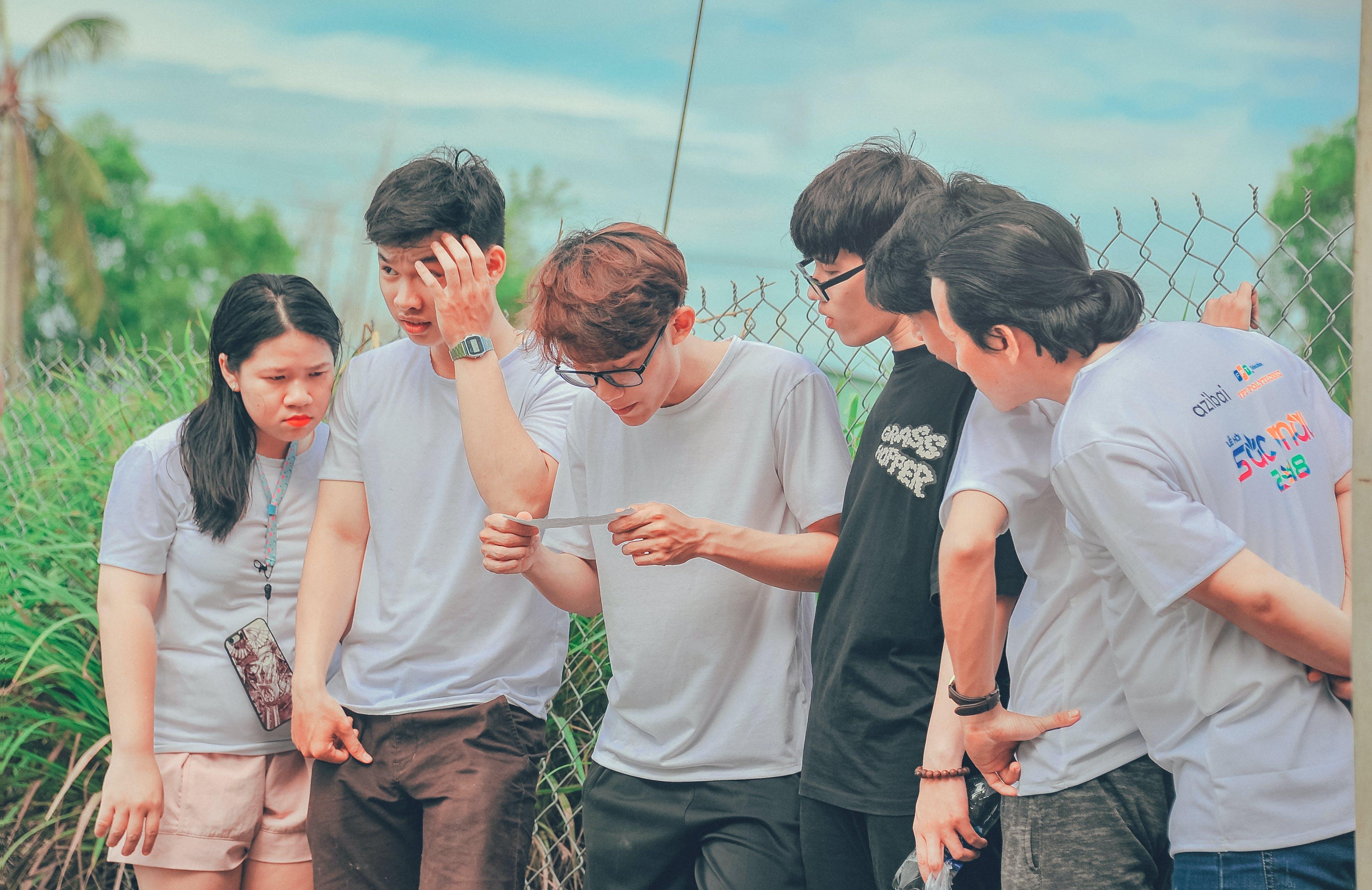 Five Men and 1 Women Wearing Crew-neck T-shirts at Daytime