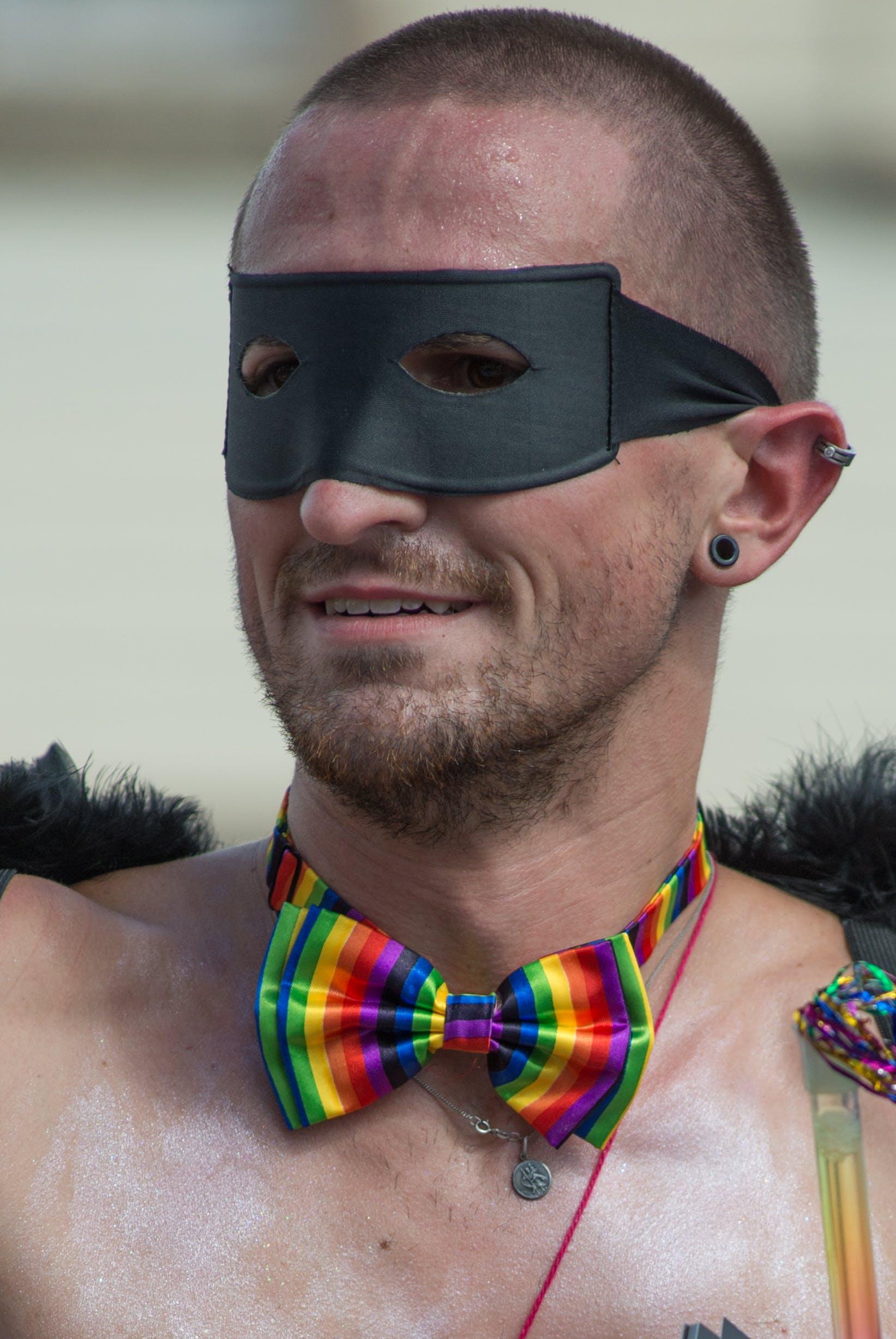 Man Wears Black Mask