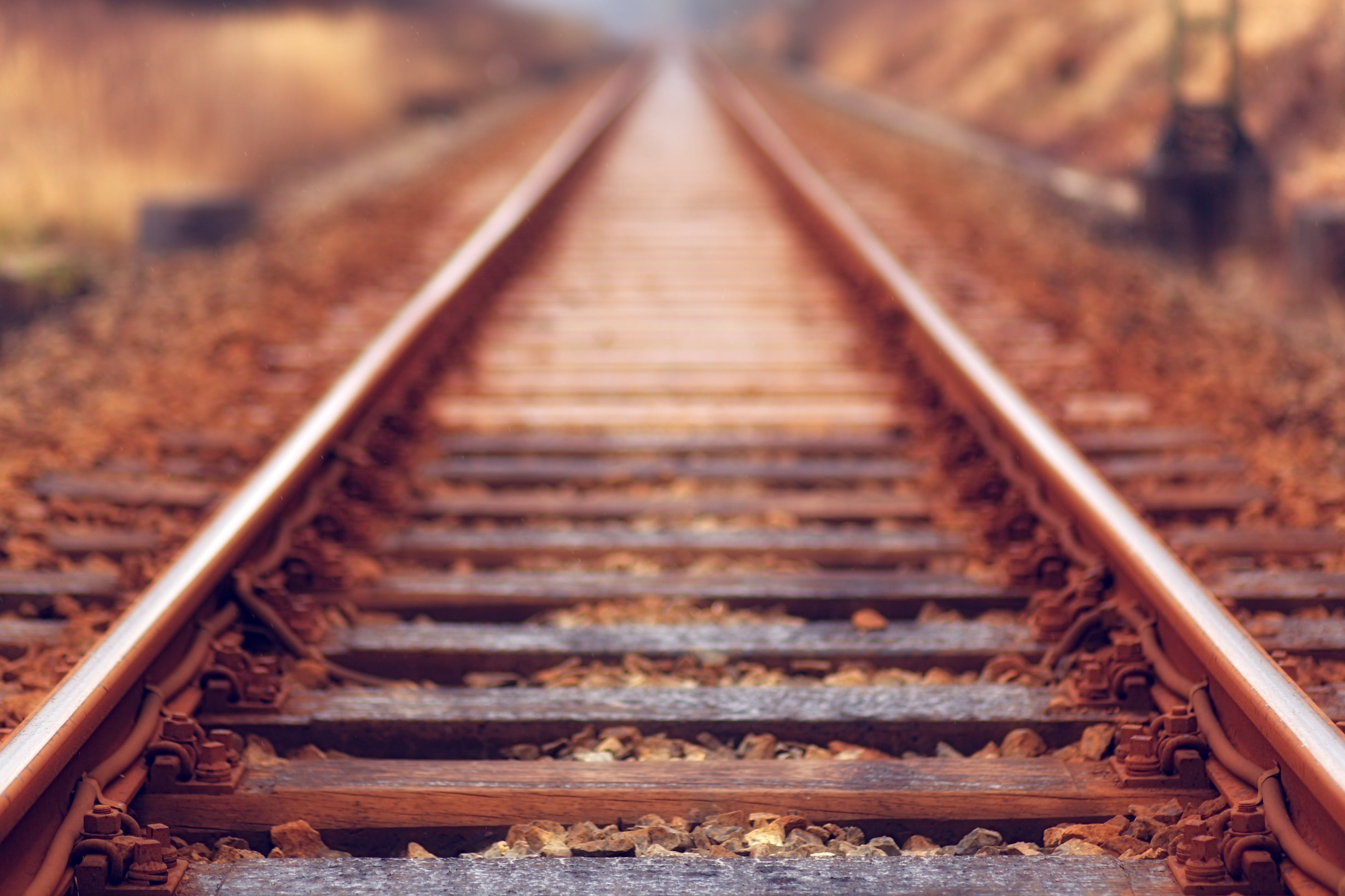Shallow Focus Photo of Train Rail