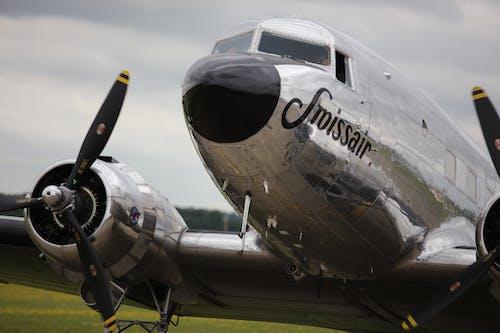 Sroissair Plane Under Gray Sky at Daytime