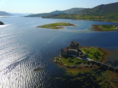 Fotos de stock gratuitas de castillo, cielo azul, foto con dron, mar
