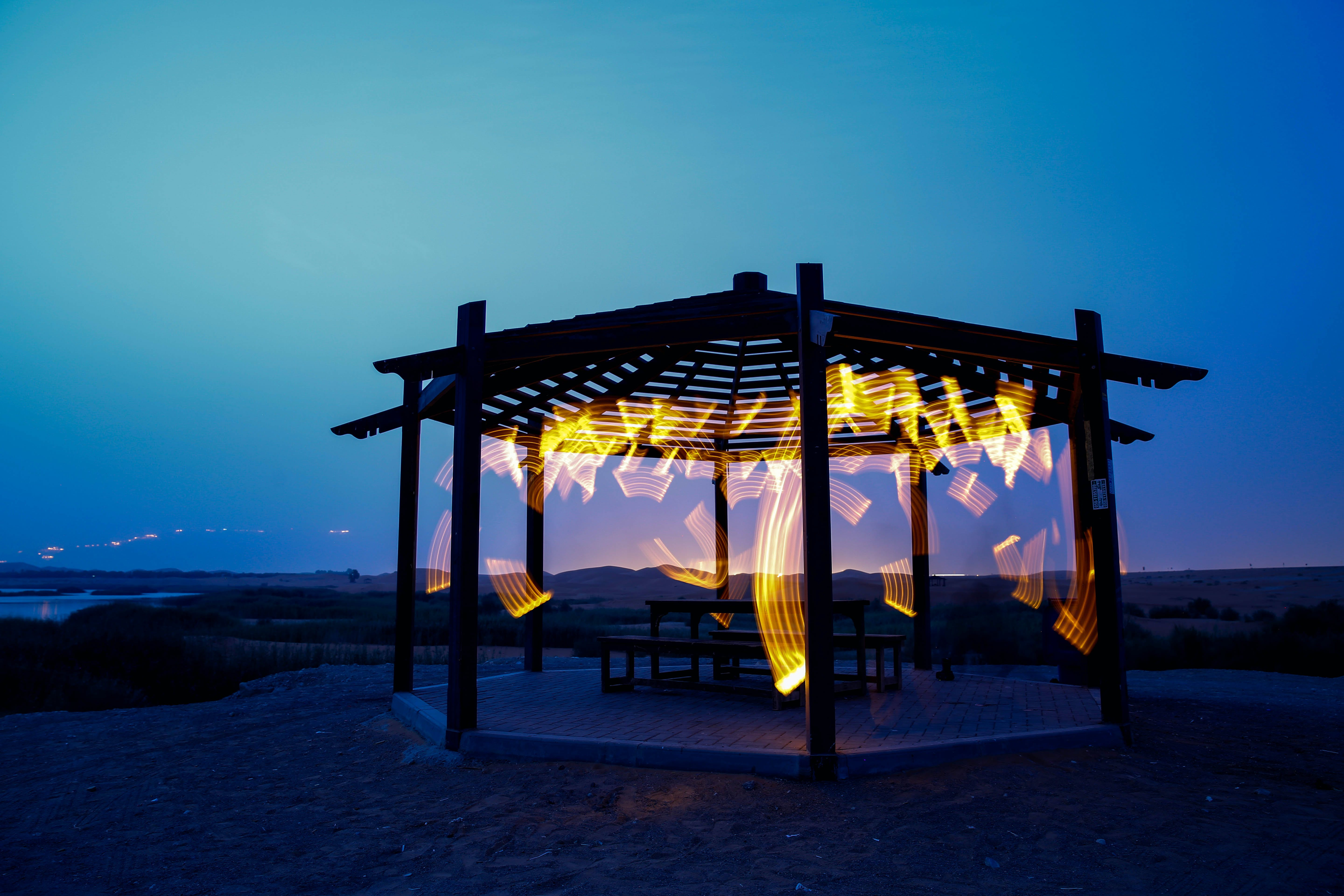 Brown Wooden Gazebo Near Sea