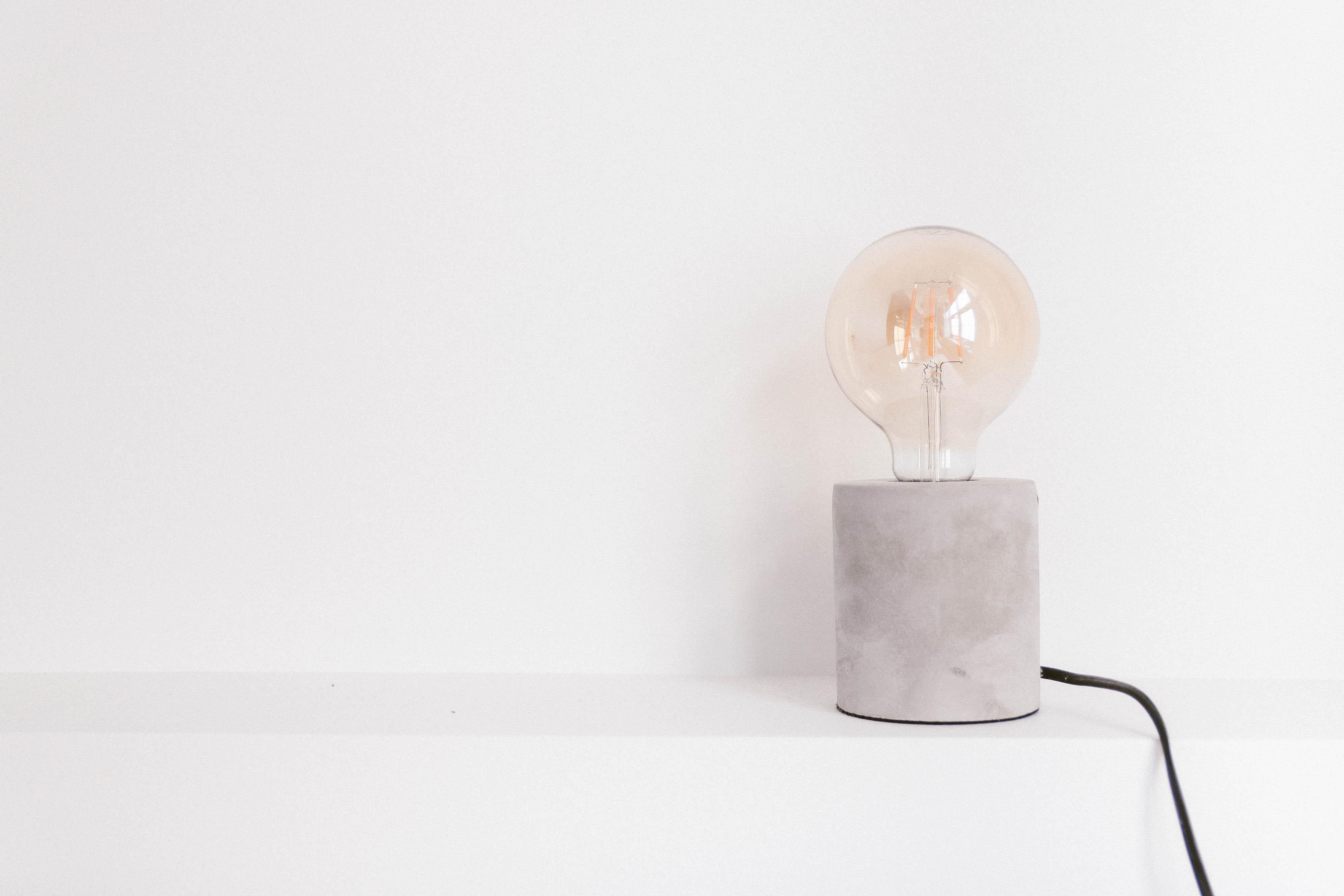 Light Bulb on White Panel