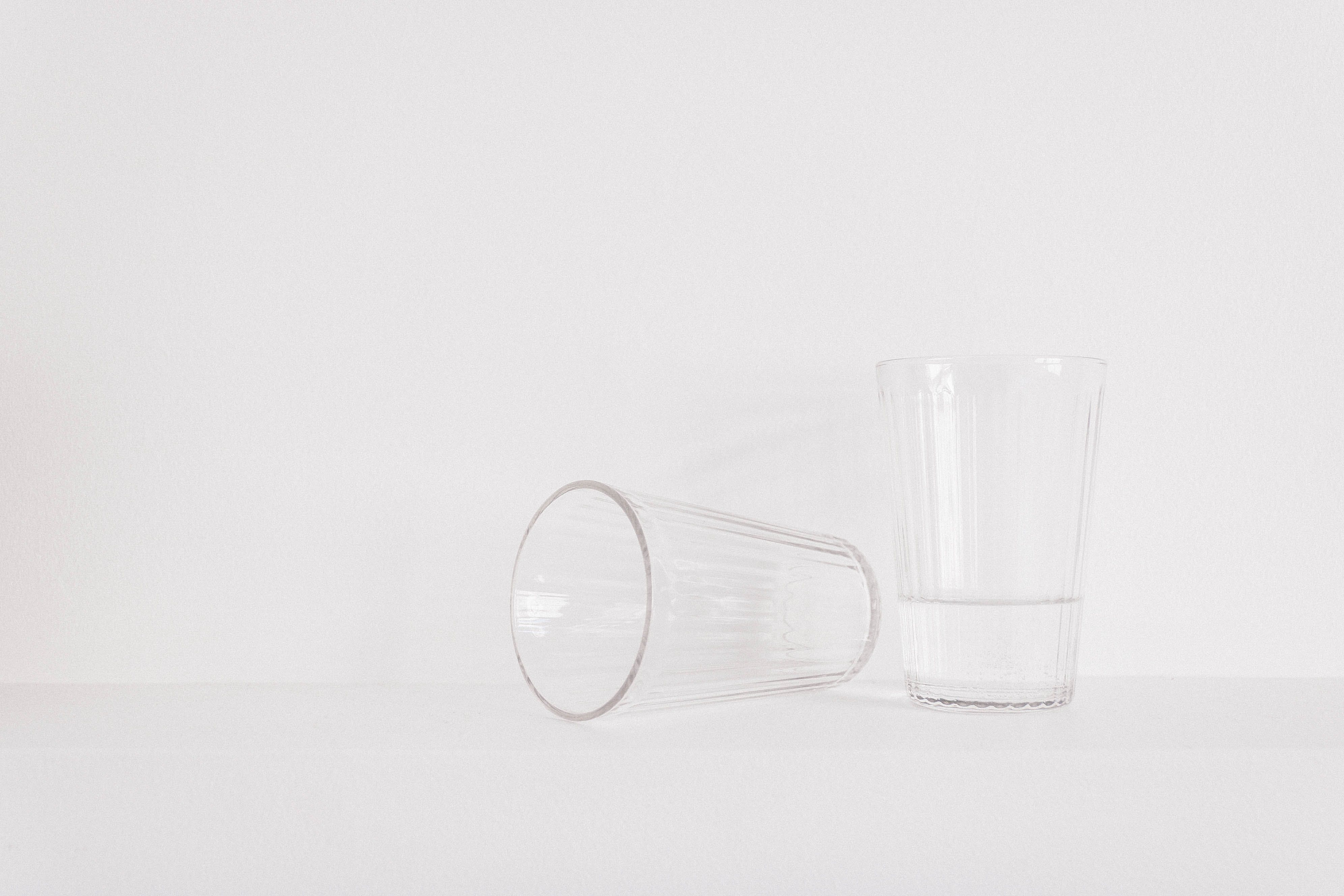 Two Clear Drinking Glasses on Table