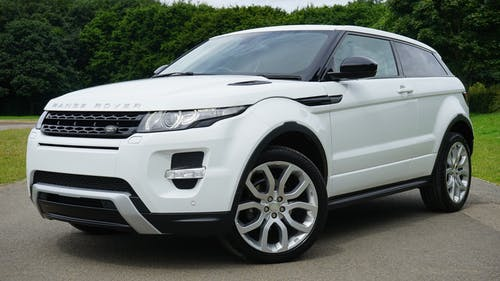 White Land Rover Range Rover Suv on Road