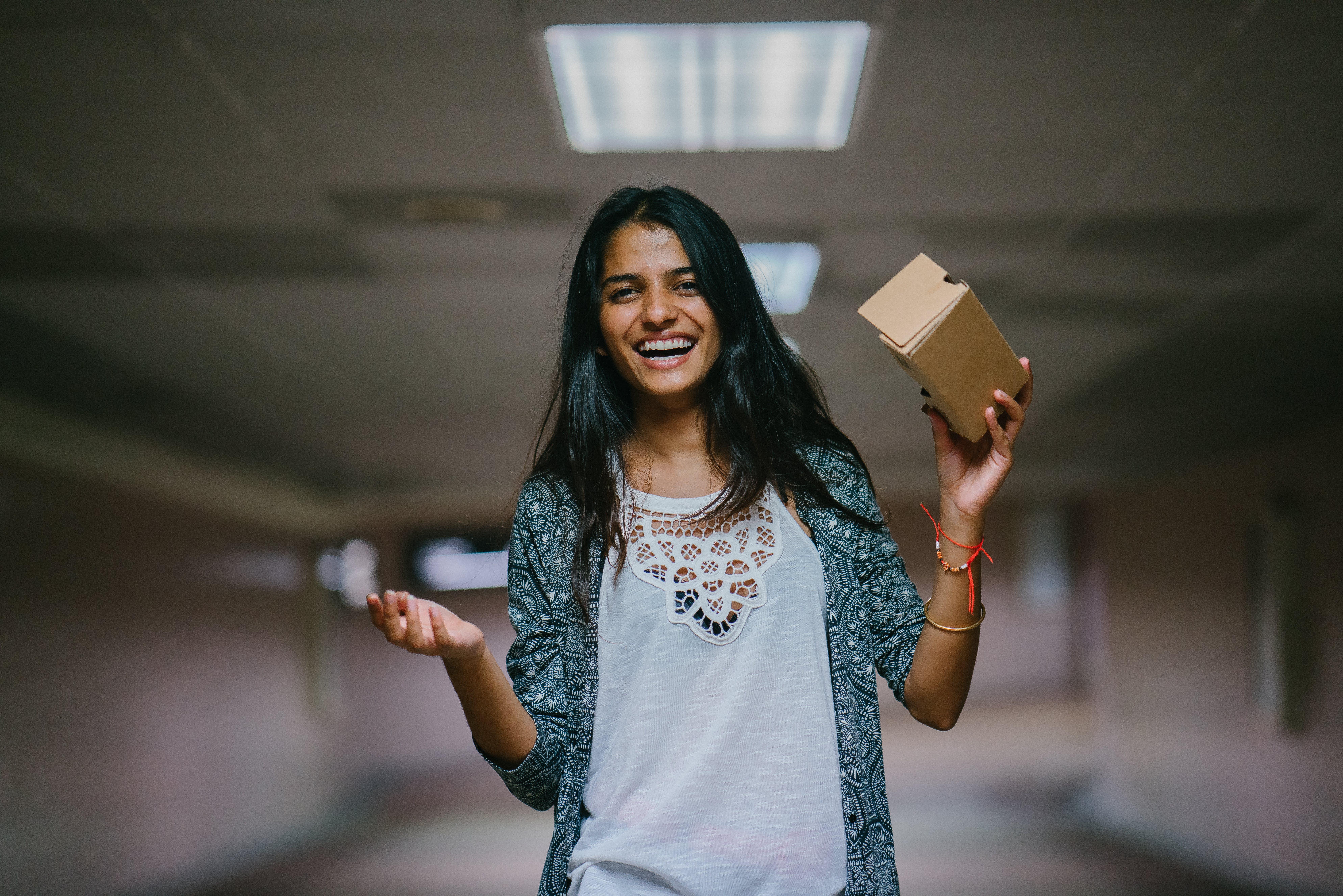 Woman Holding Brown Cardboard Box