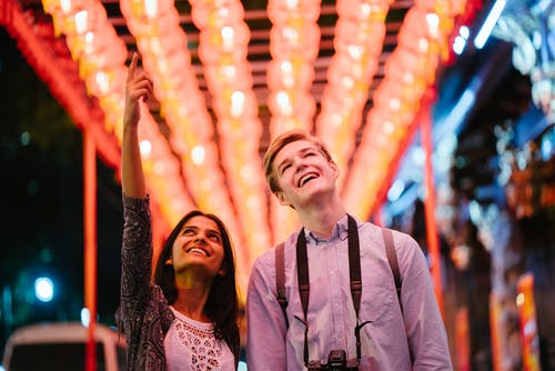 Photo of Man and Woman Looking Up
