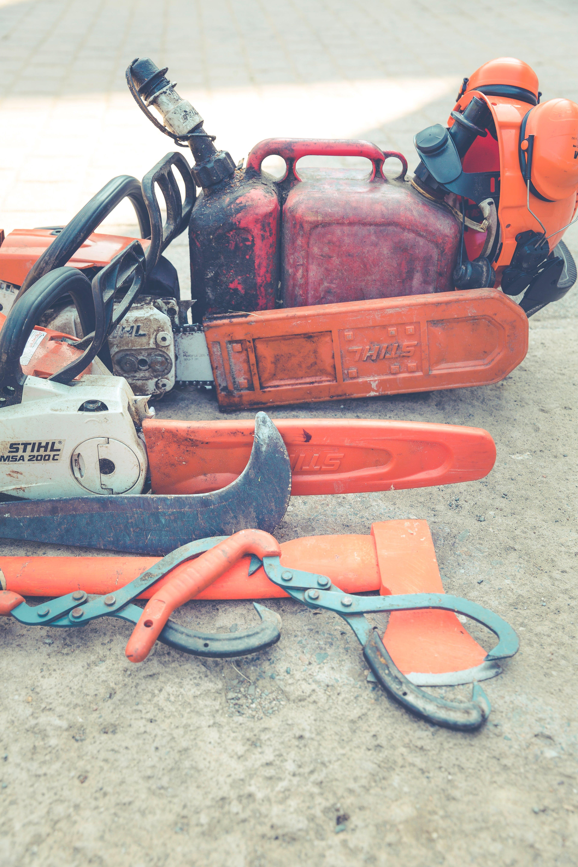 Orange and White Stihl 200 C Chainsaw