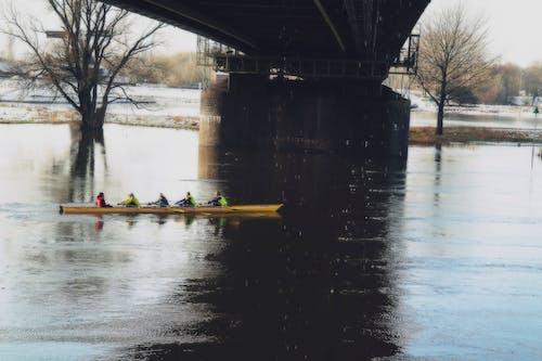 Person Riding Kayak on River